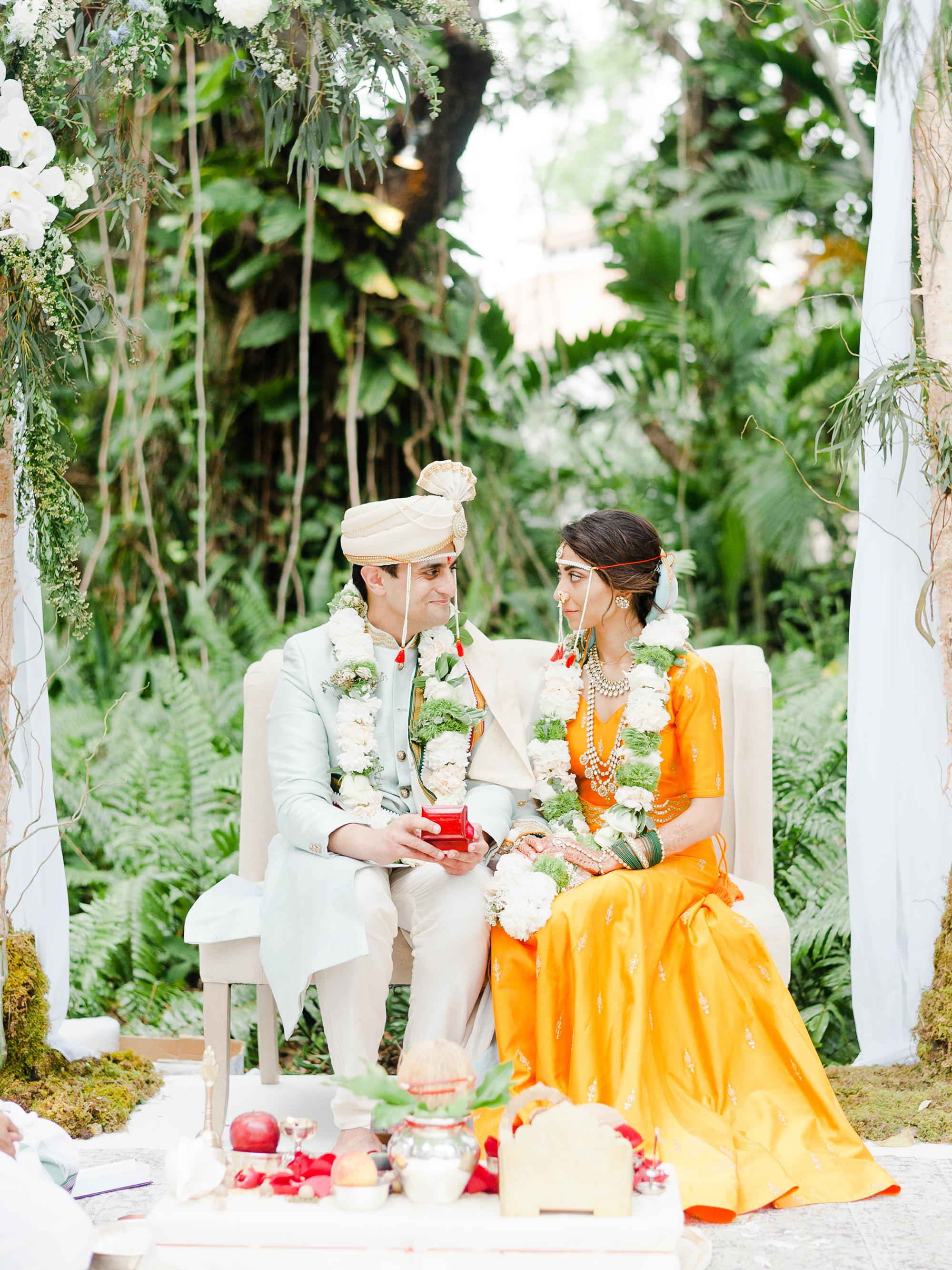 anuja nikhil wedding ceremony bride and groom sitting
