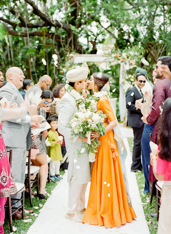 anuja nikhil wedding recessional kiss