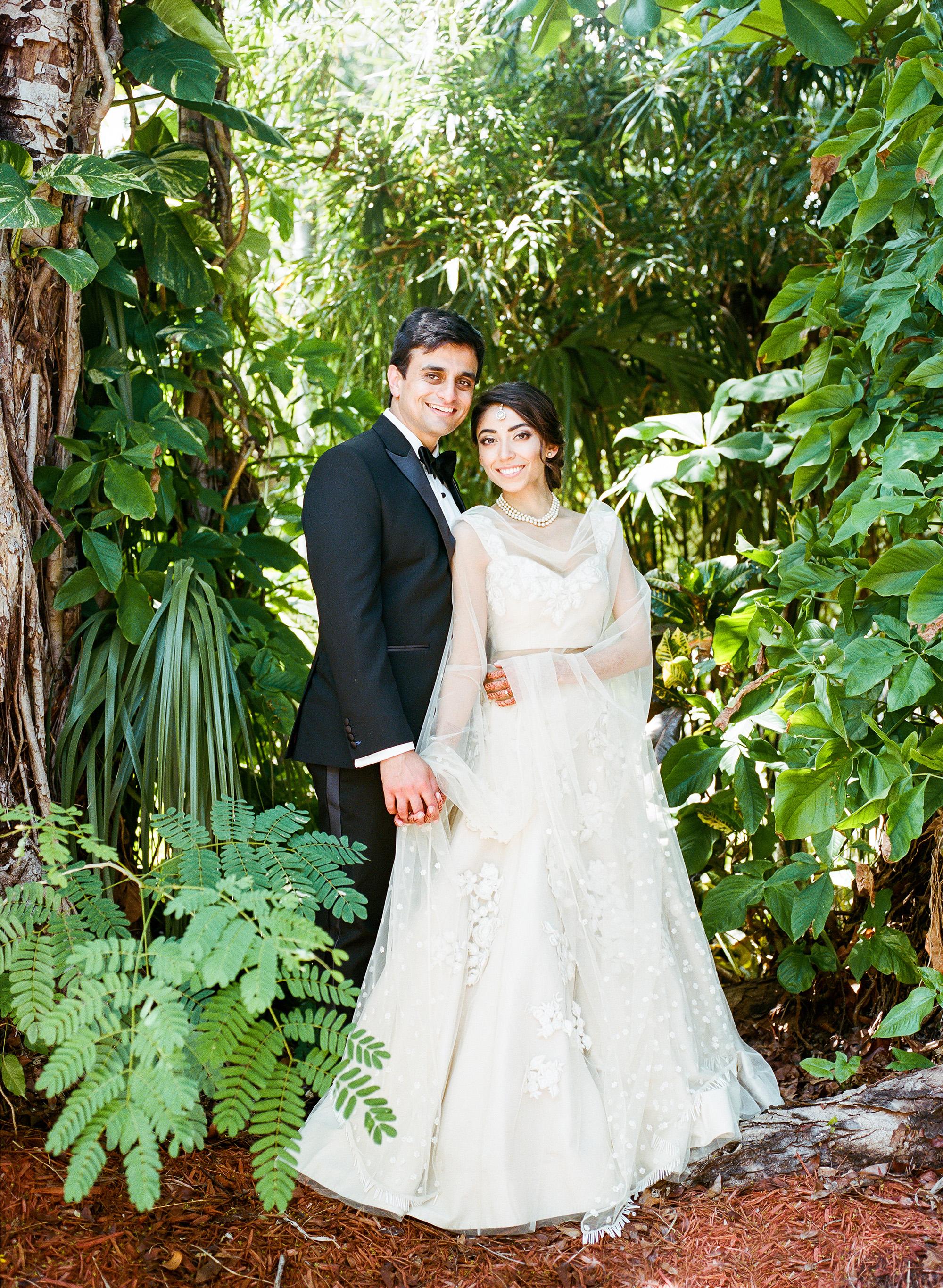 anuja nikhil wedding ceremony couple bride white dress