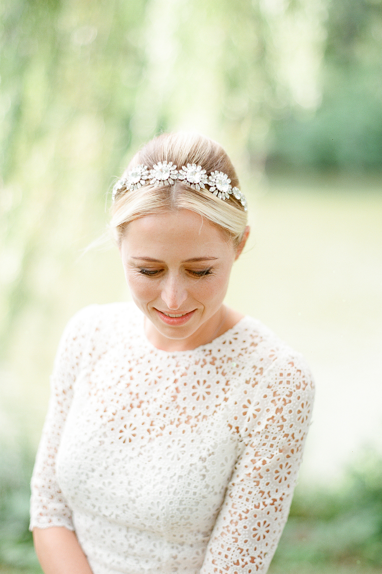 bride with high-neck dress and headband