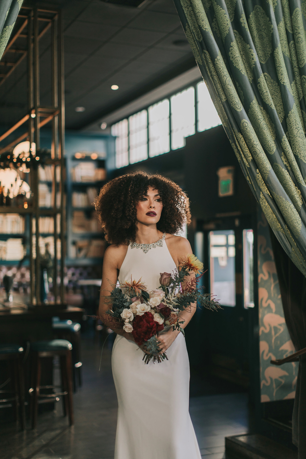 middle part hairstyles bride with curly hair with burgundy lip