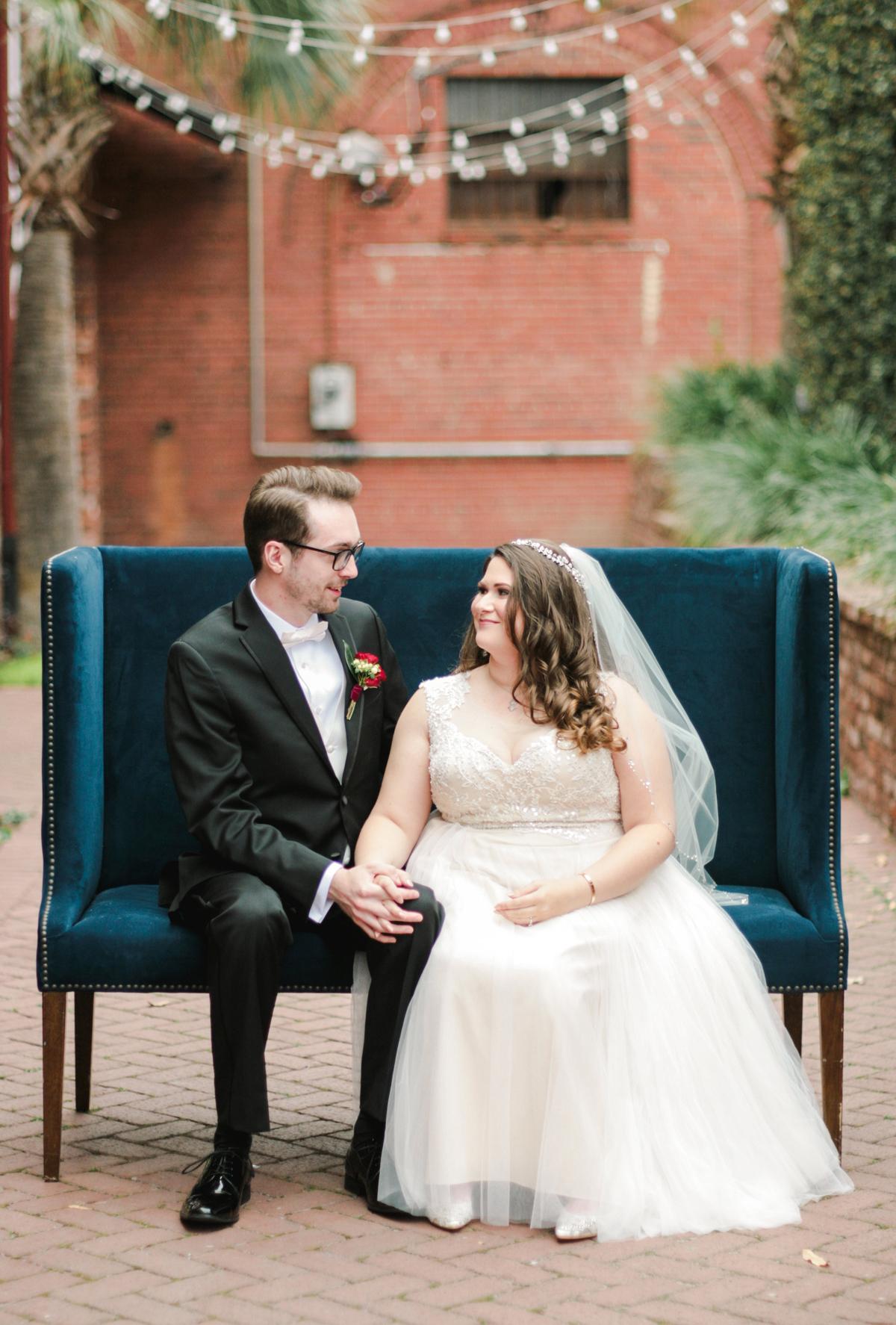 elizabeth seth wedding couple sitting on blue couch