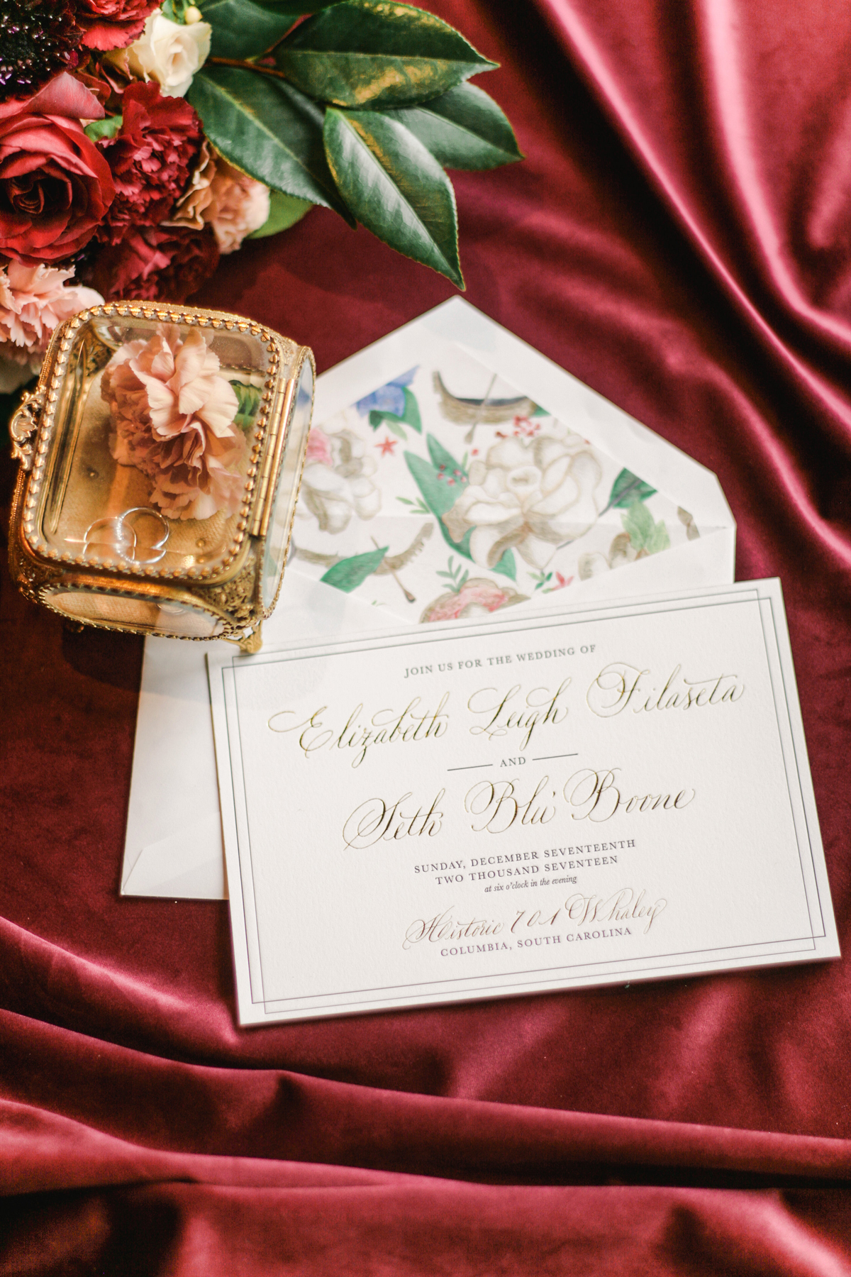 elizabeth seth wedding invitation against red drapery background