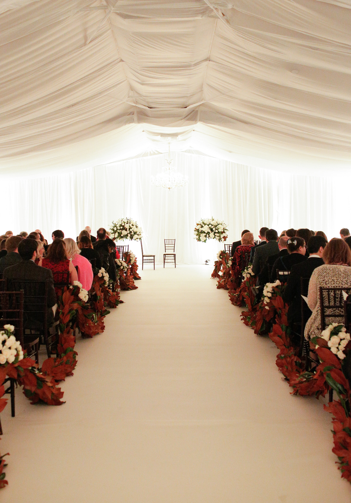 elizabeth seth wedding ceremony aisles lined with red flowers