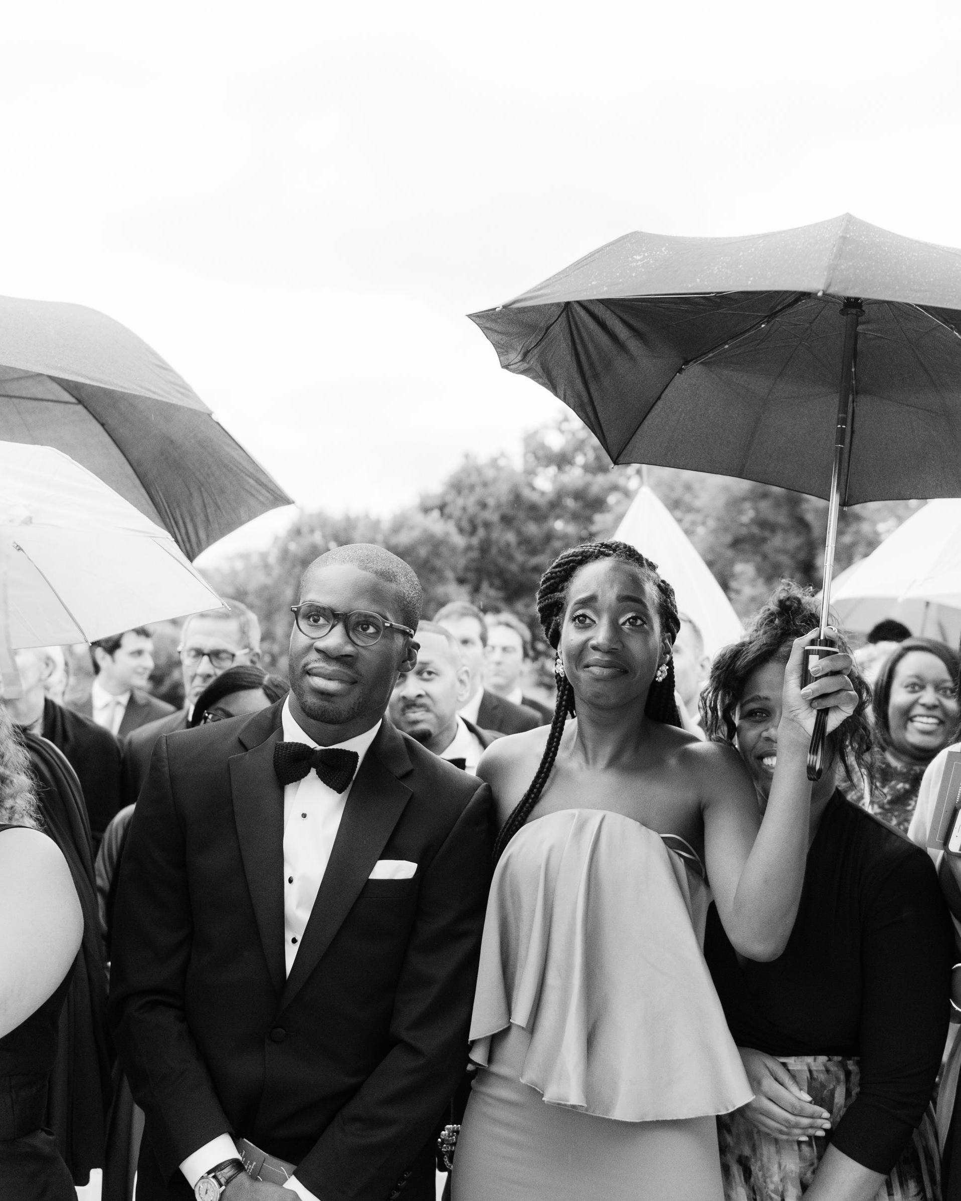melissa justen wedding ceremony guests rain umbrellas