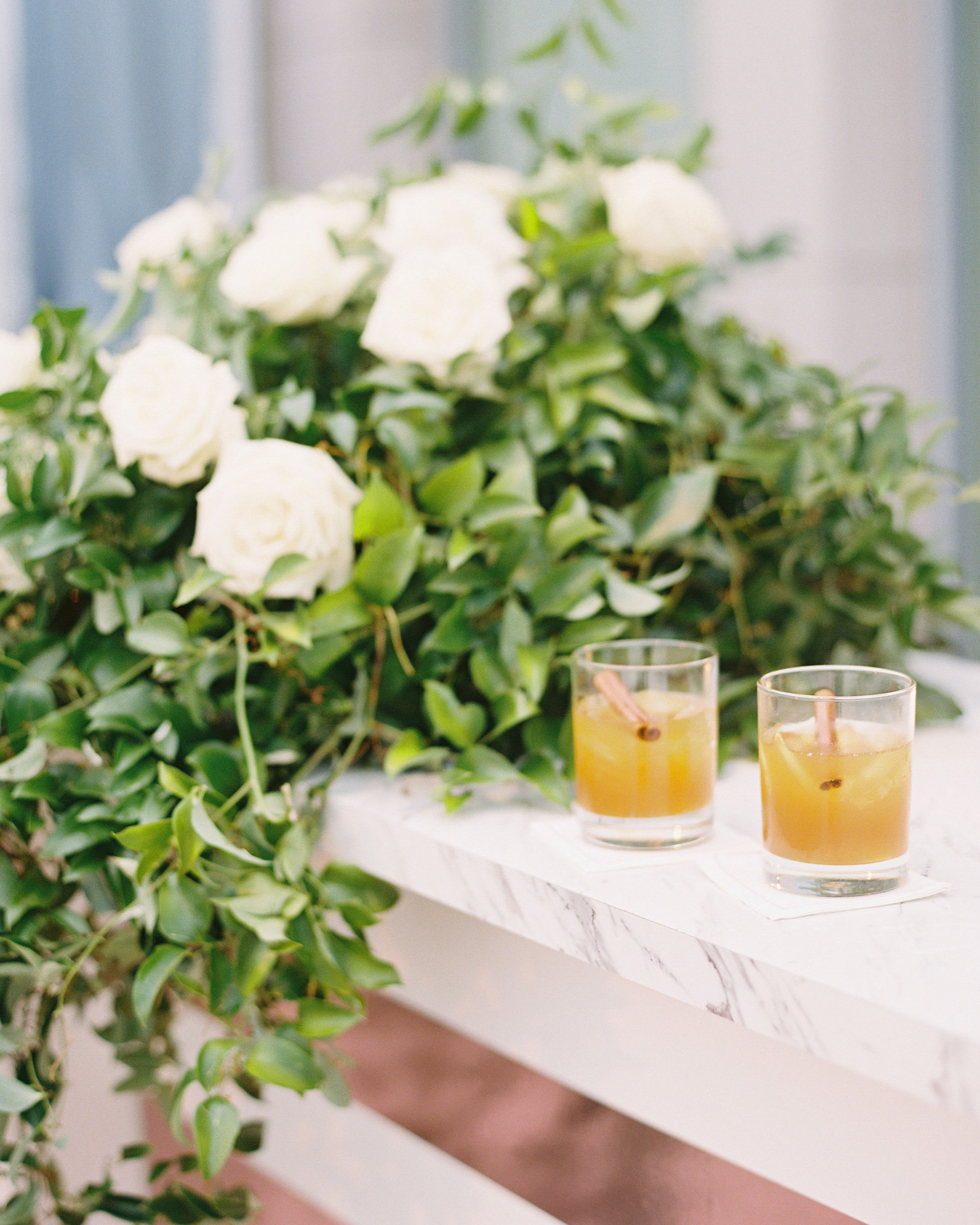 melissa justen wedding cocktails on marble table with flowers