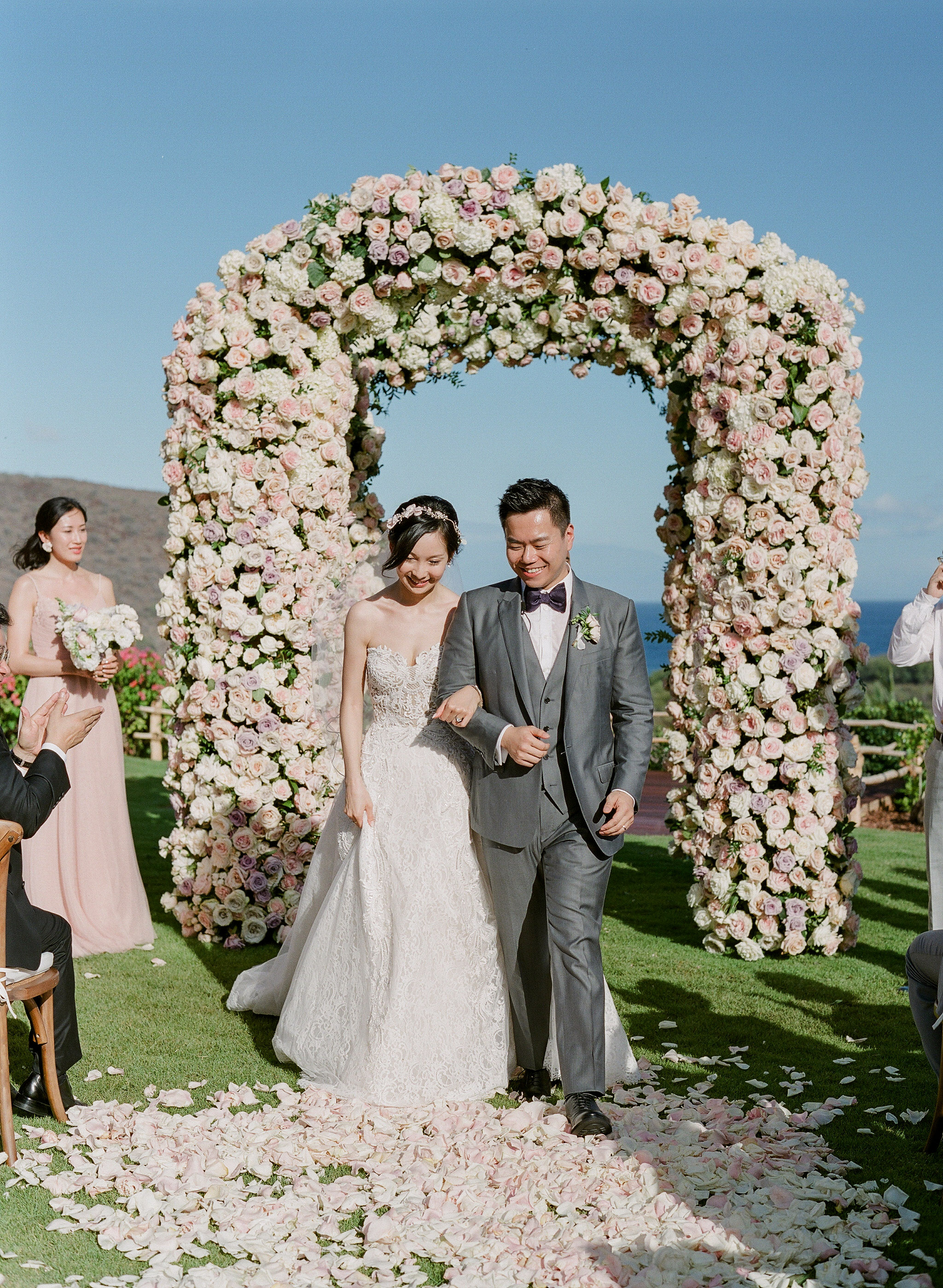 hawaii wedding bride groom recessional rose petals