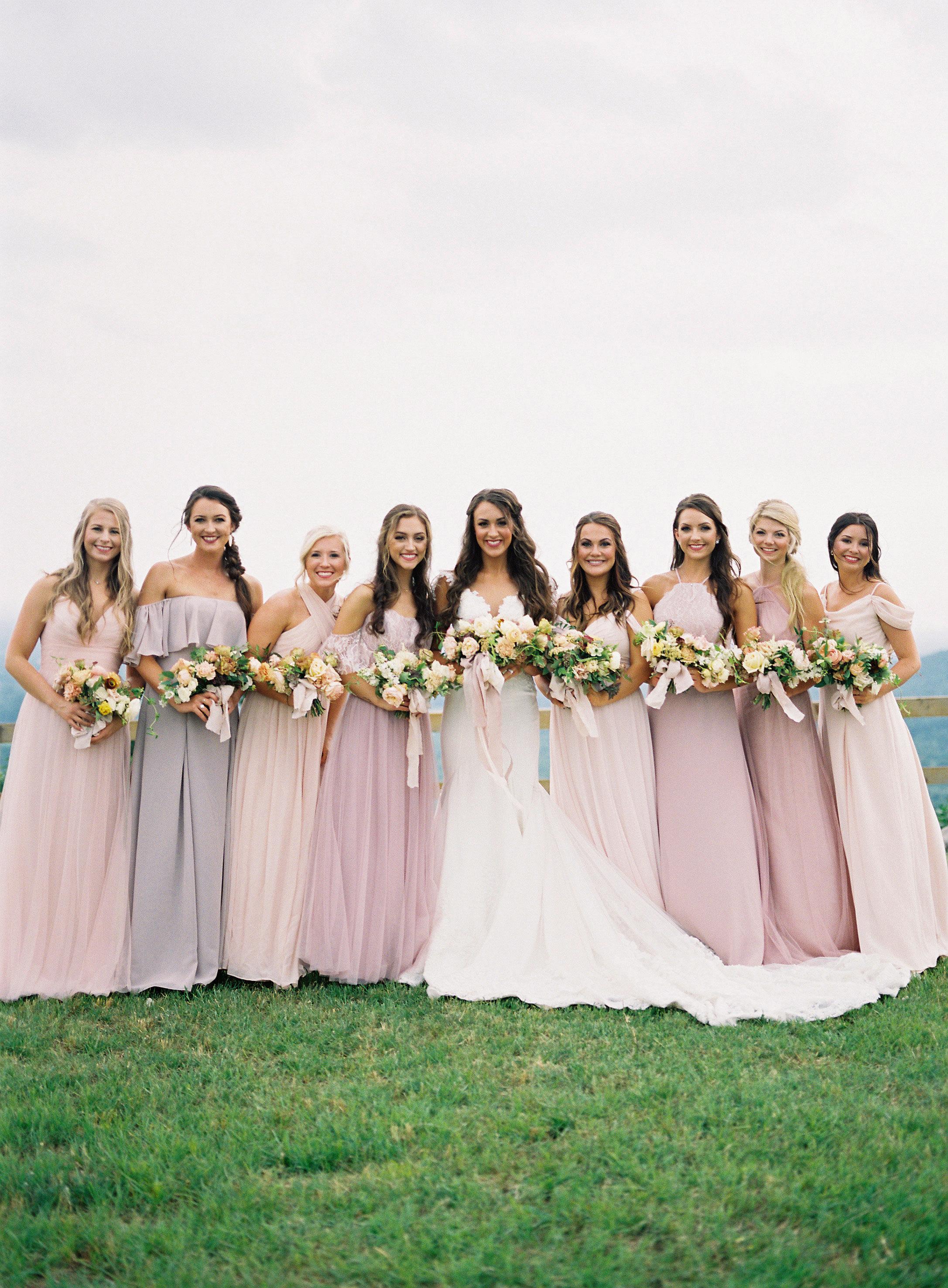 bride and bridesmaids outdoors pink shade dresses