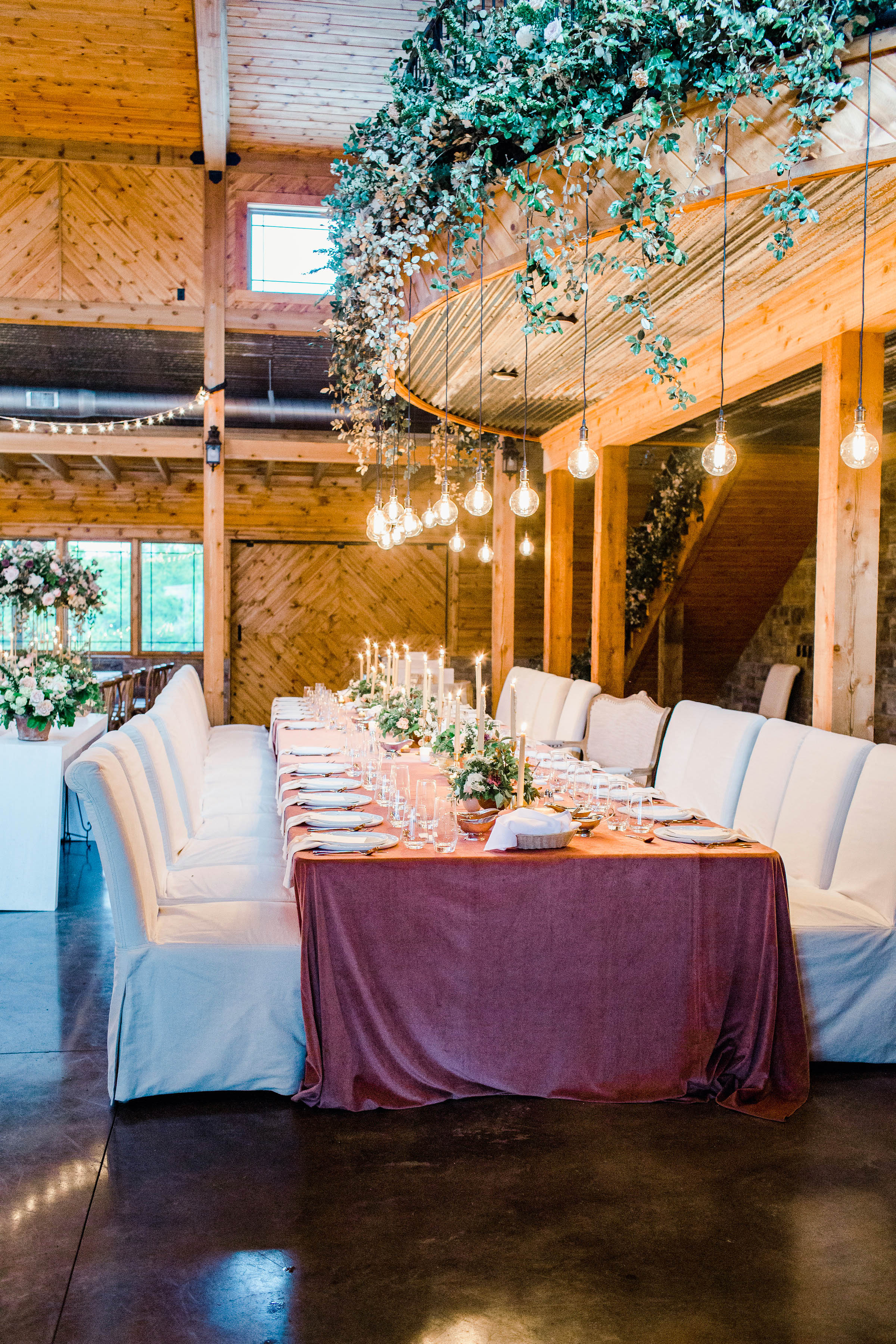 wedding party table below hanging lights