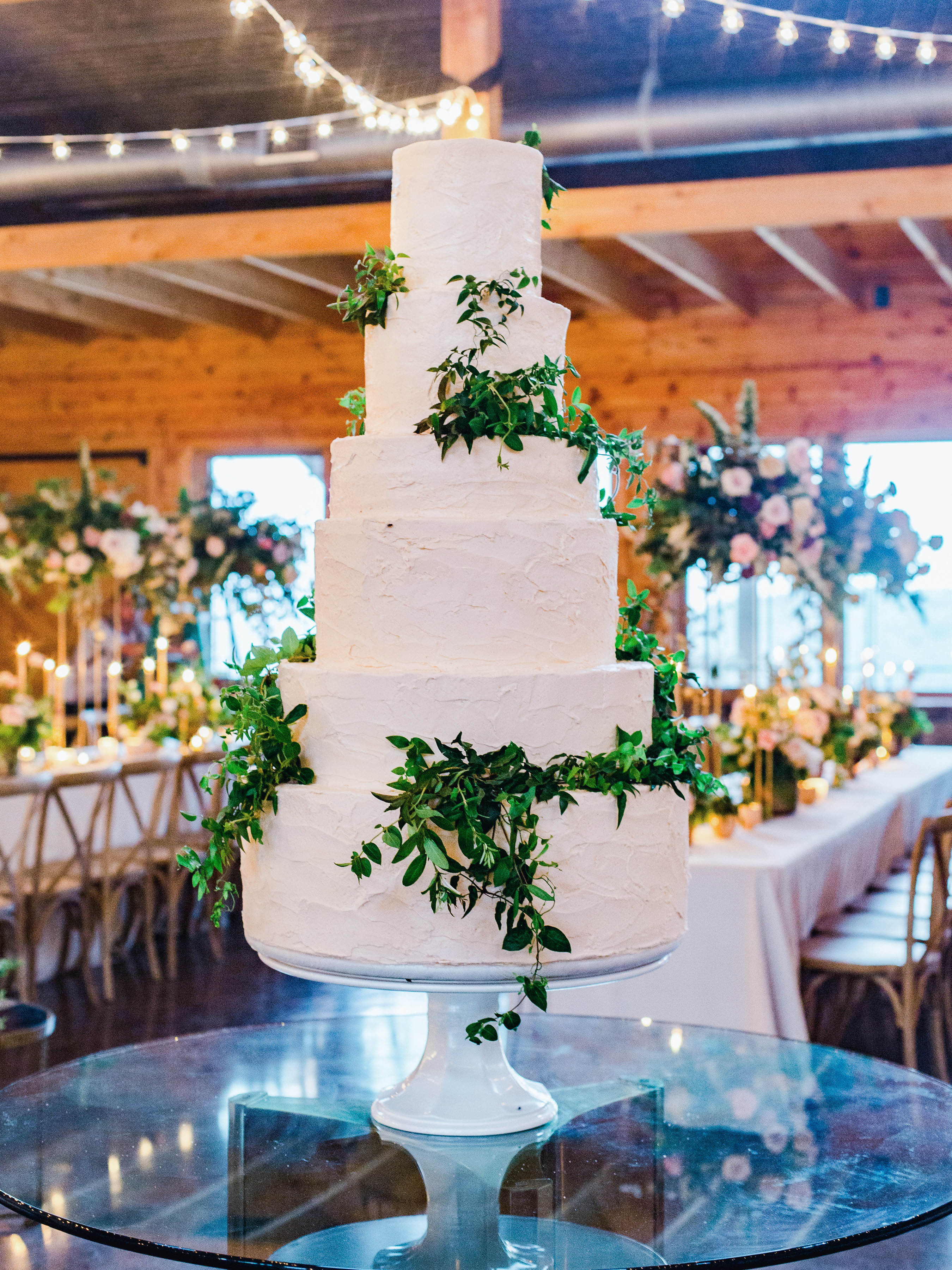 pink strawberry champagne tiered cake with greenery