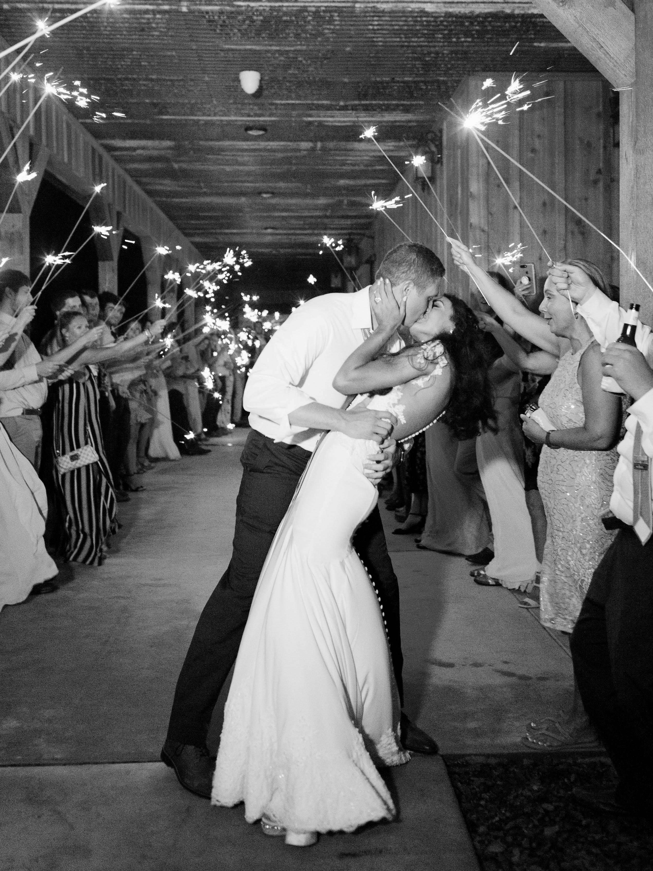 wedding couple kiss under sparklers