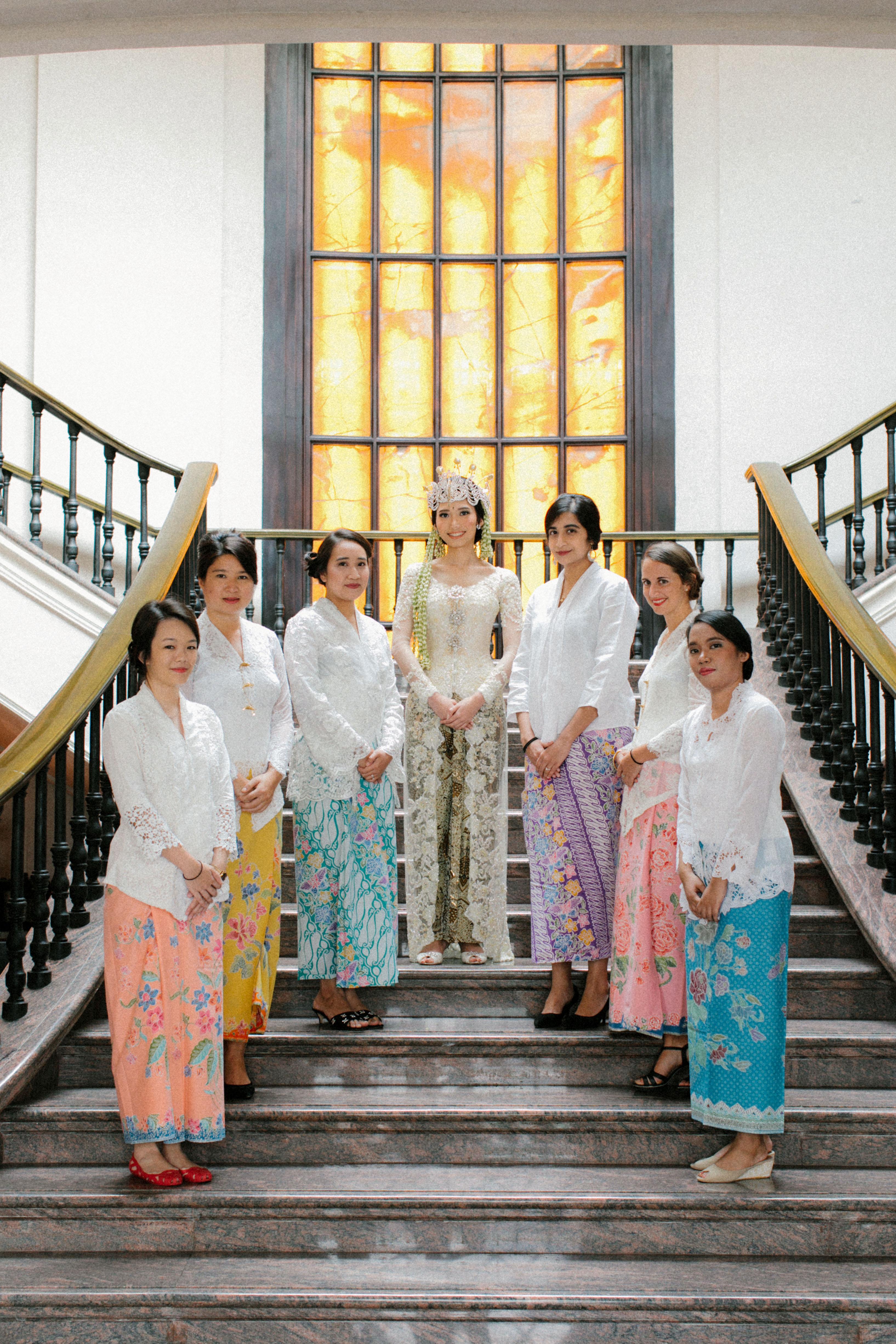 wedding bride bridesmaid group pose on stairway