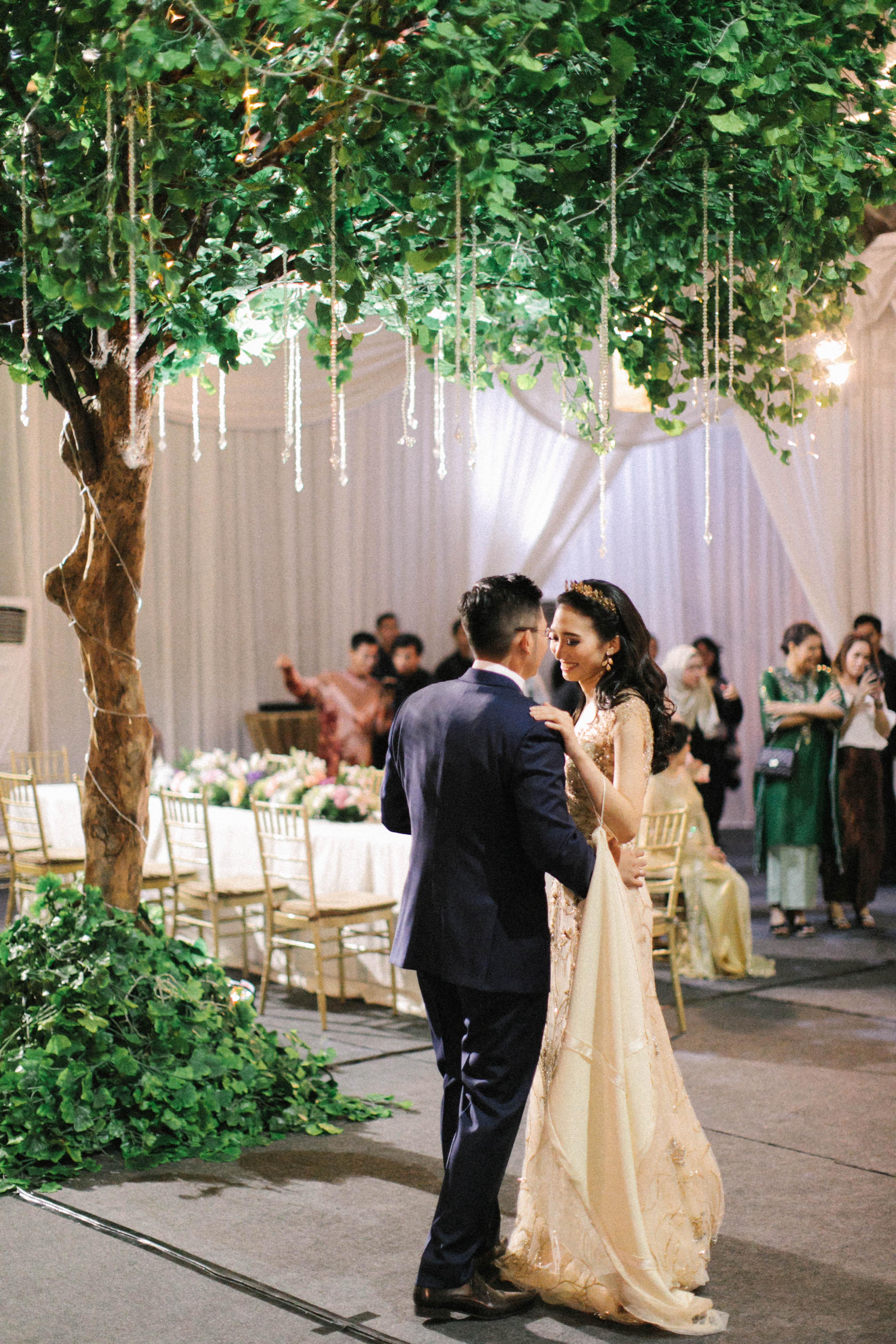 wedding reception bride groom first dance under tree lighting