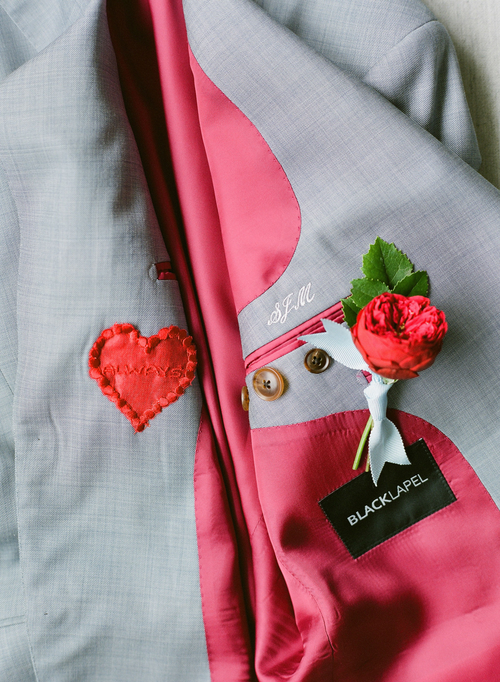 colleen stephen newport wedding grooms jacket with red heart patch