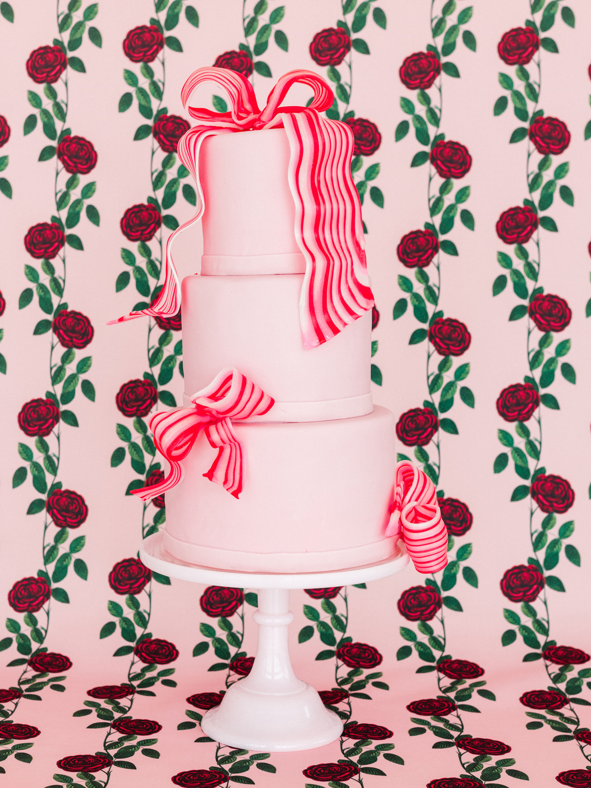 colleen stephen newport wedding pink wedding cake with sugar ribbons