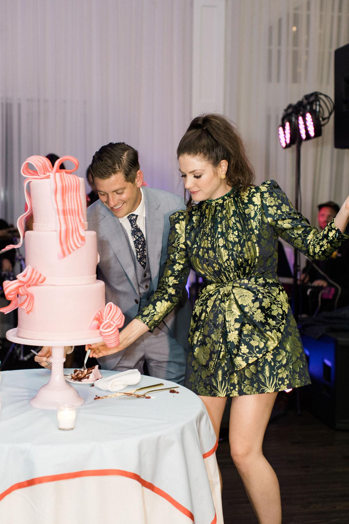 colleen stephen newport wedding couple cutting pink wedding cake