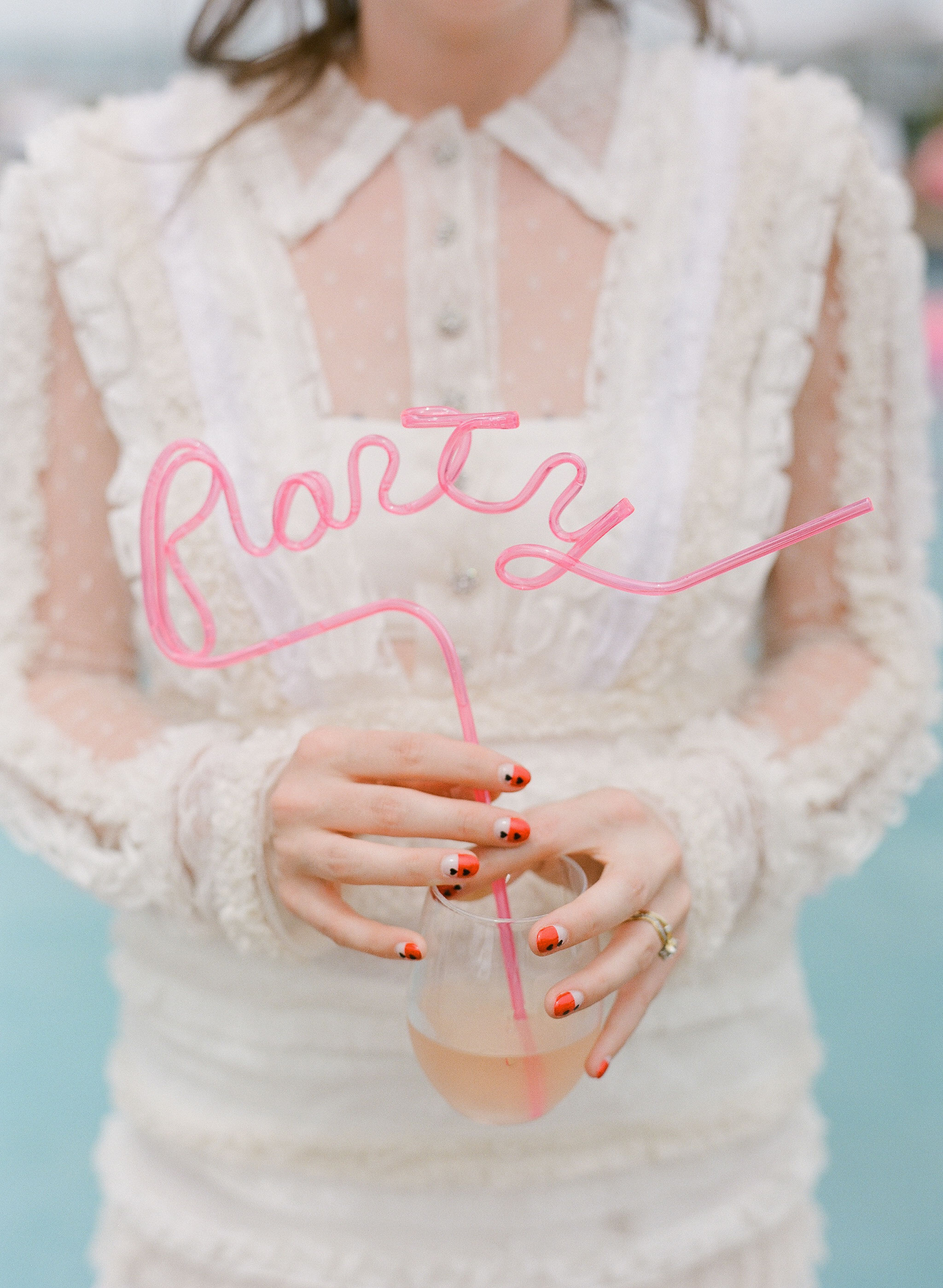colleen stephen newport wedding drink with curly pink party straw