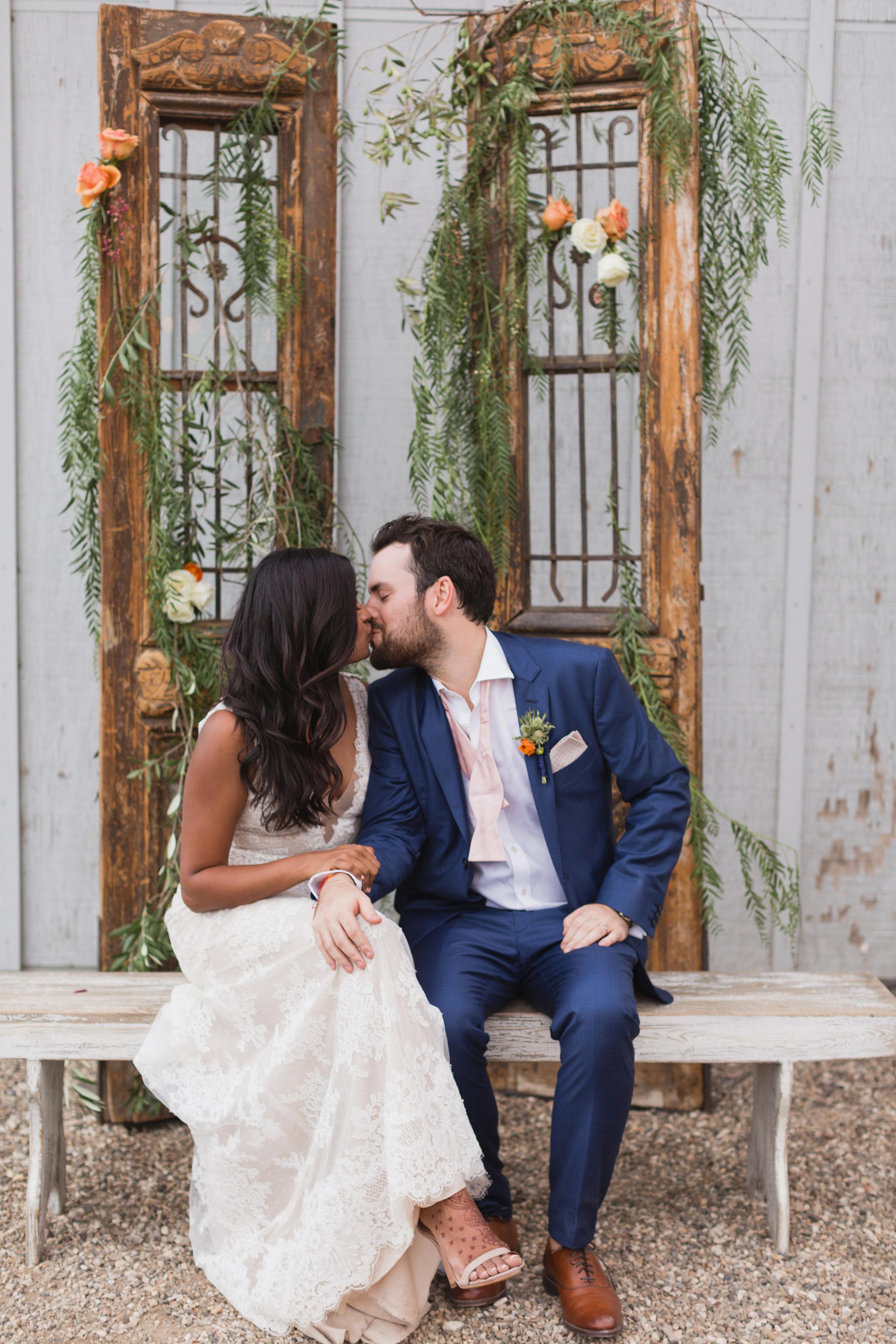 kosha and adam wedding couple sitting and kissing