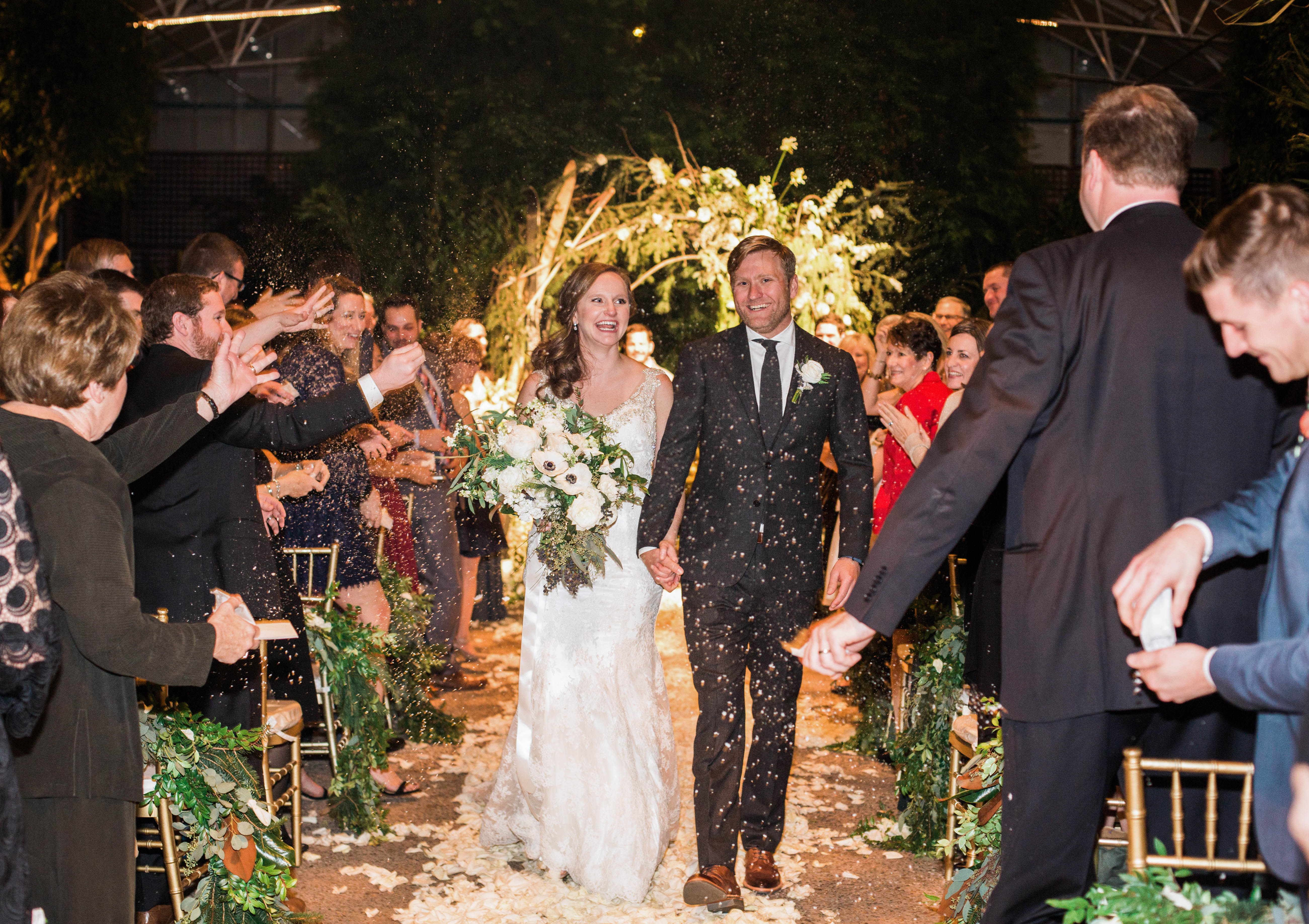 wedding recessional bride groom hold hands guests applaud