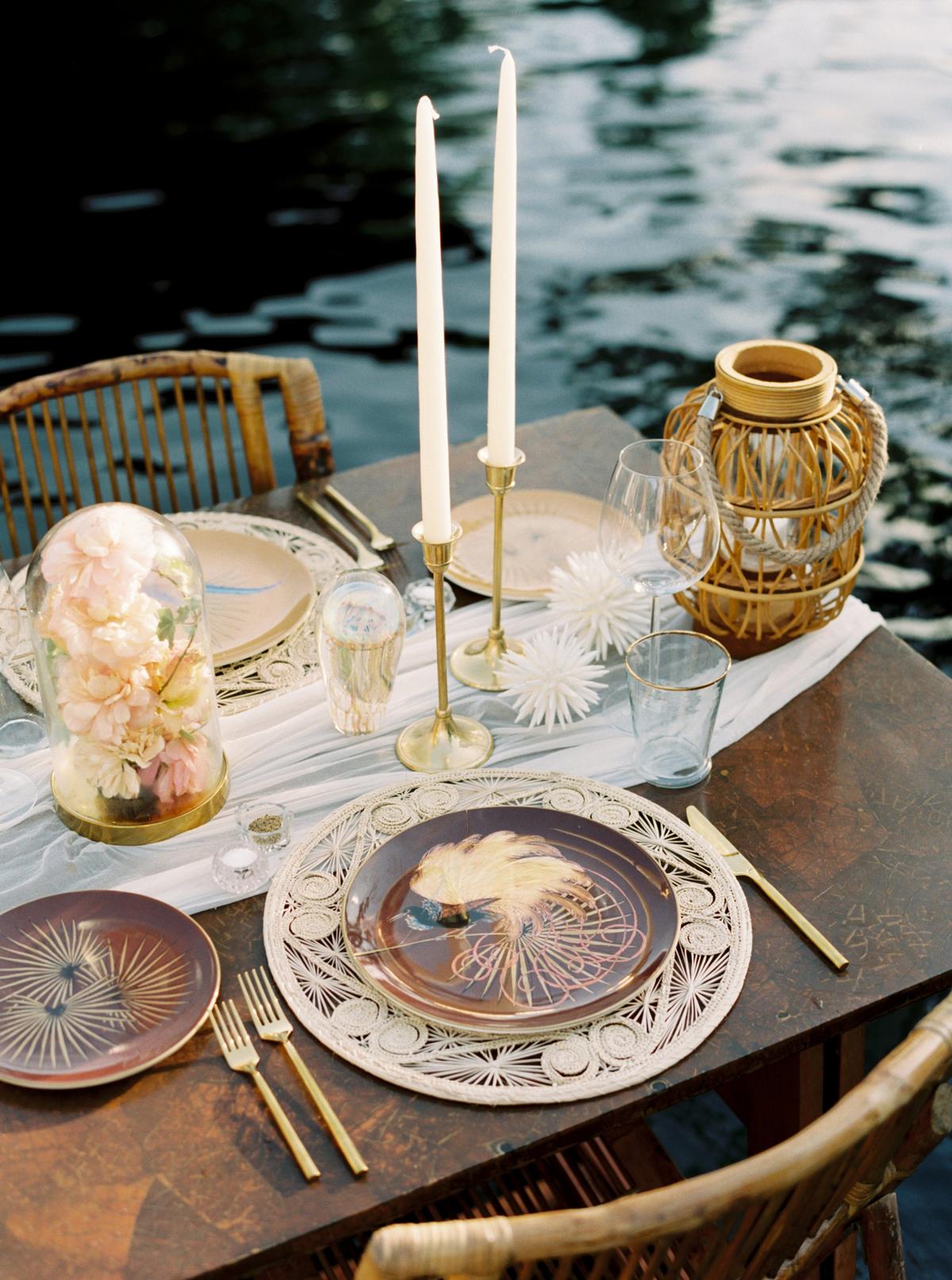 turks and caicos shoot erich mcvey tablescape brown plates rattan florals