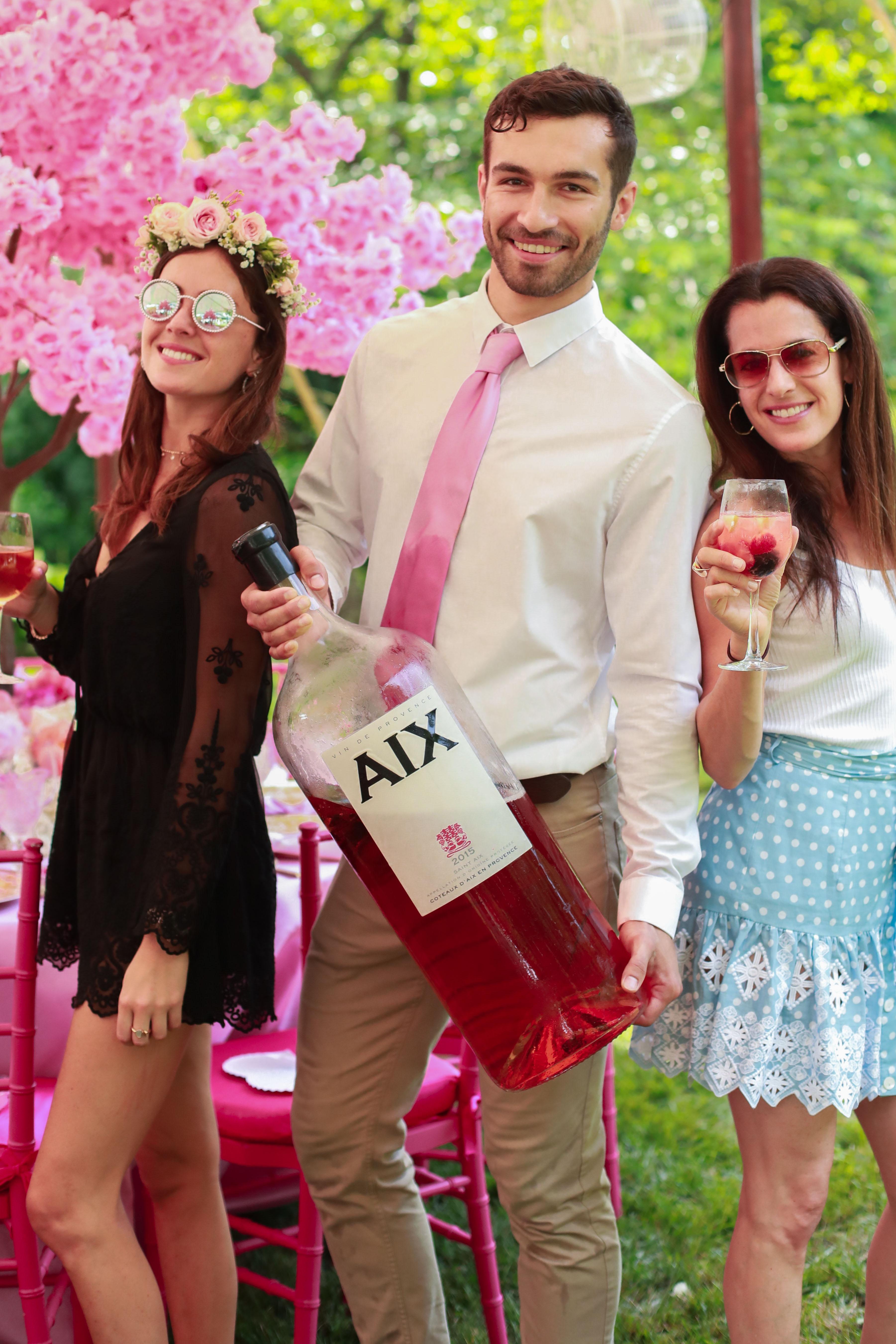 bridal shower guests enjoying large bottle wine