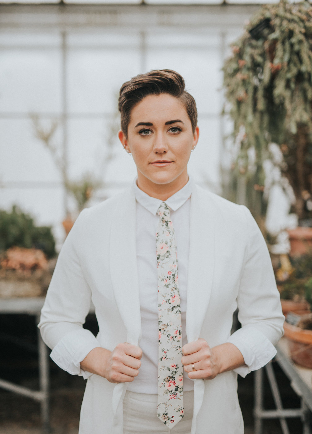elopement outfit inspiration bride wearing white suit