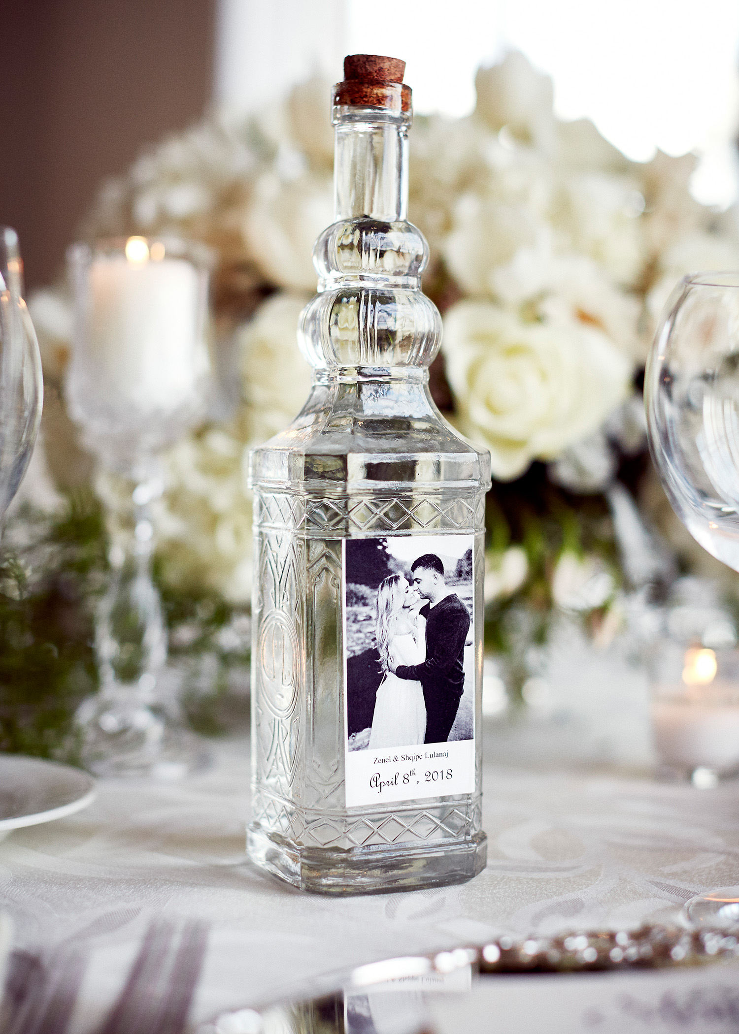 shqipe zenel wedding vodka bottle on table with flowers