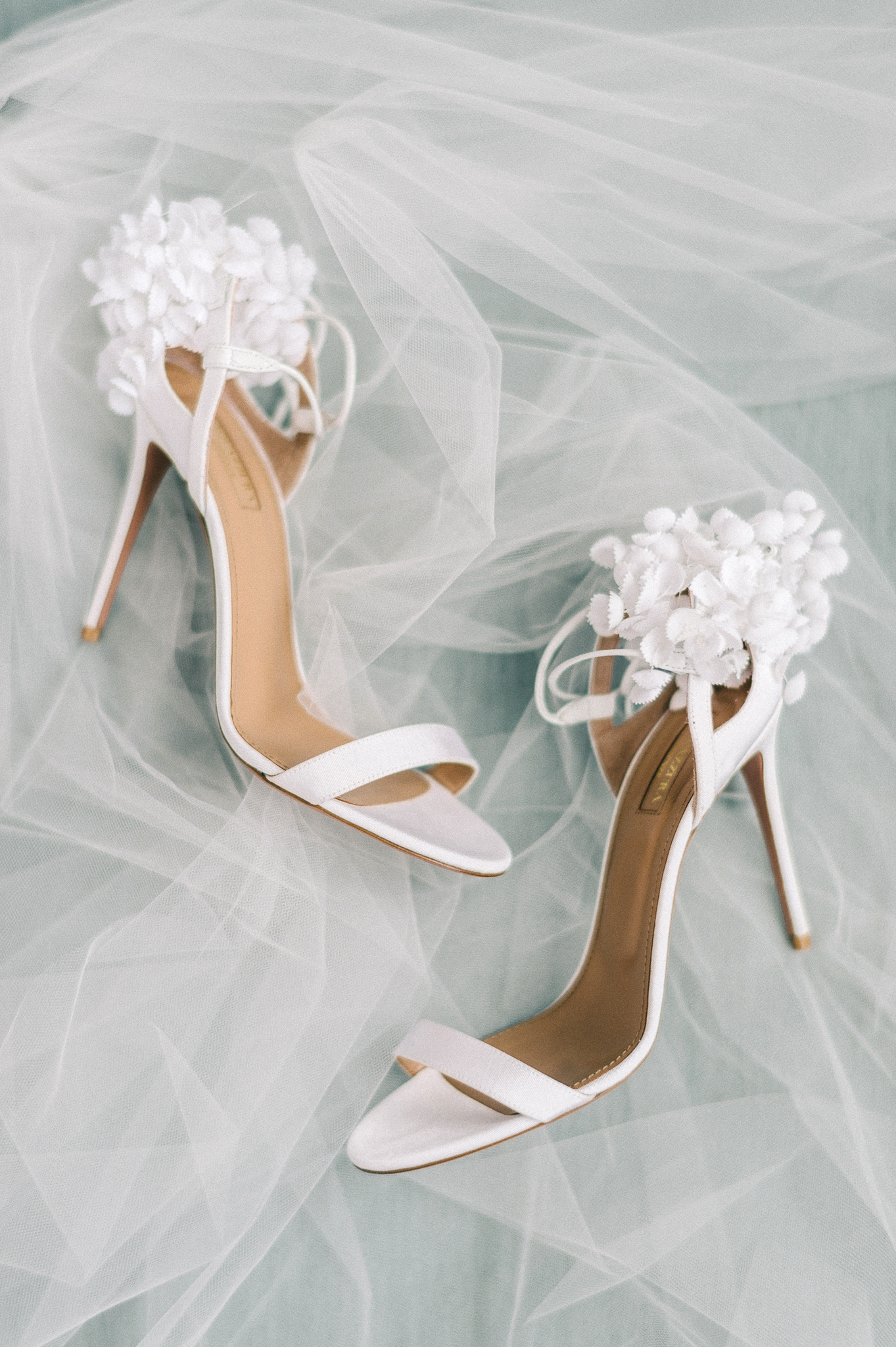 How to Make Sure Your Wedding Dress Won't Drag on the Floor If You Change Shoes During the Reception