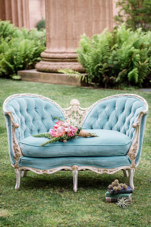 blue velvet chaise lounge on lawn