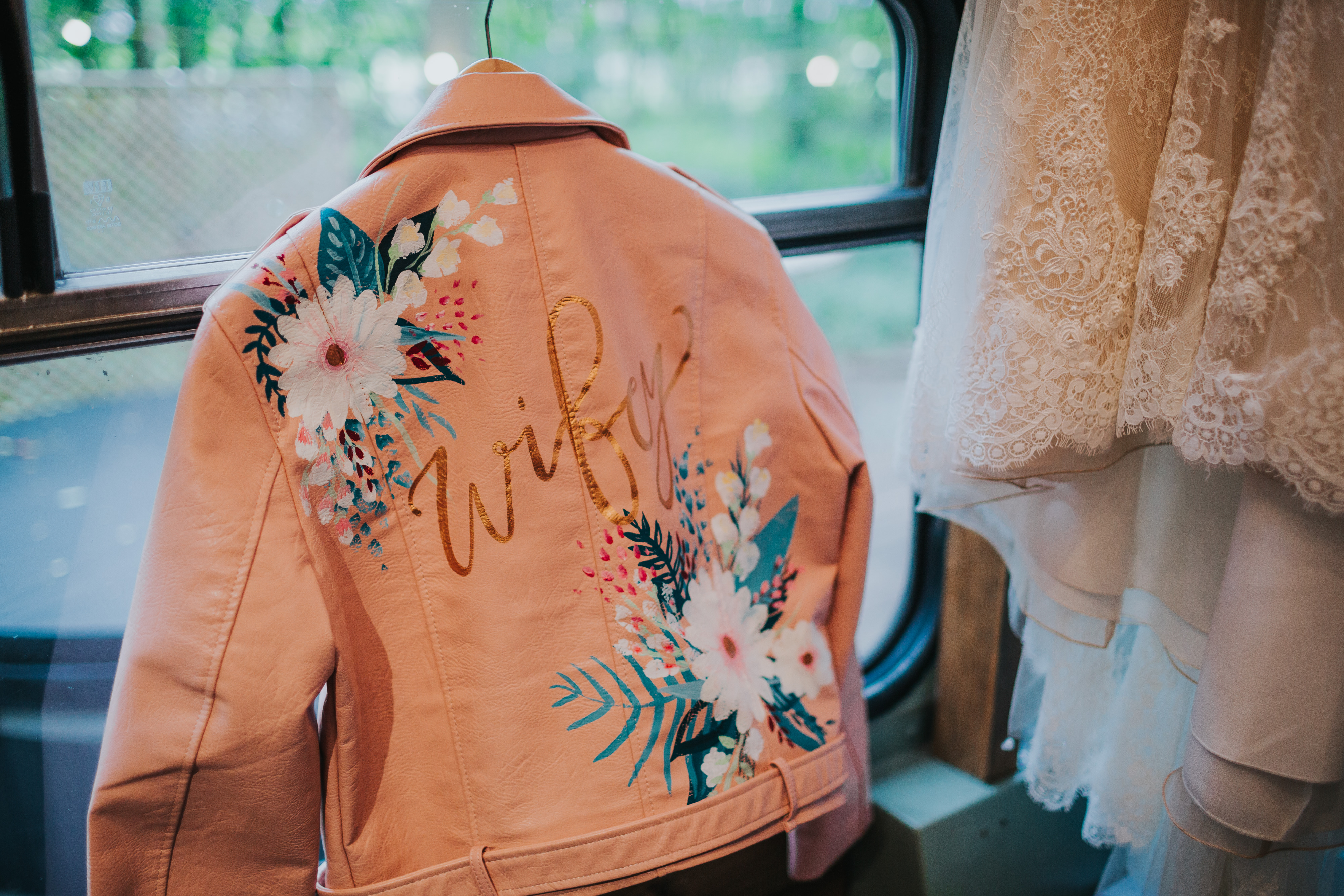 pink leather jacket with painted name and flowers