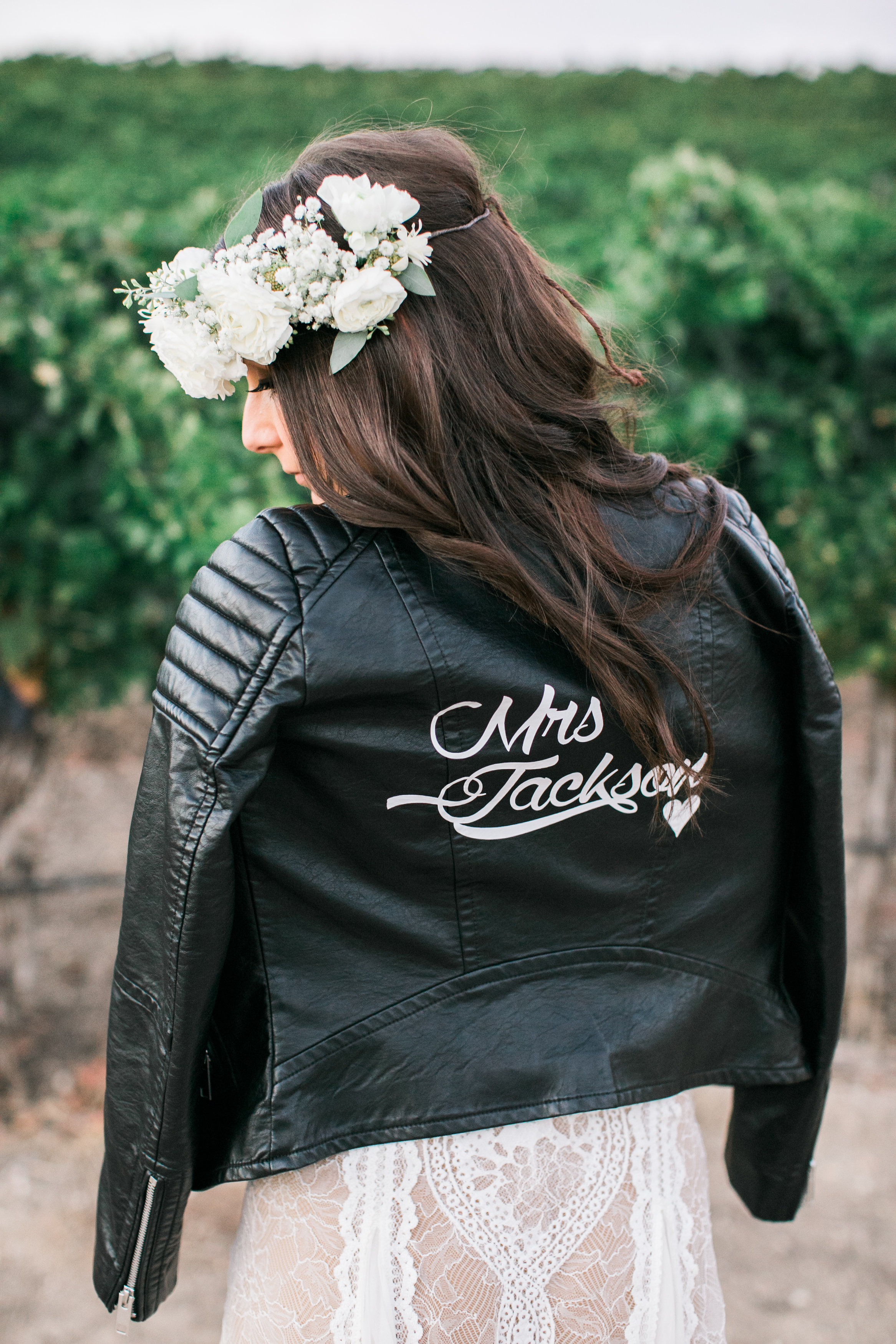 black leather jacket with painted name