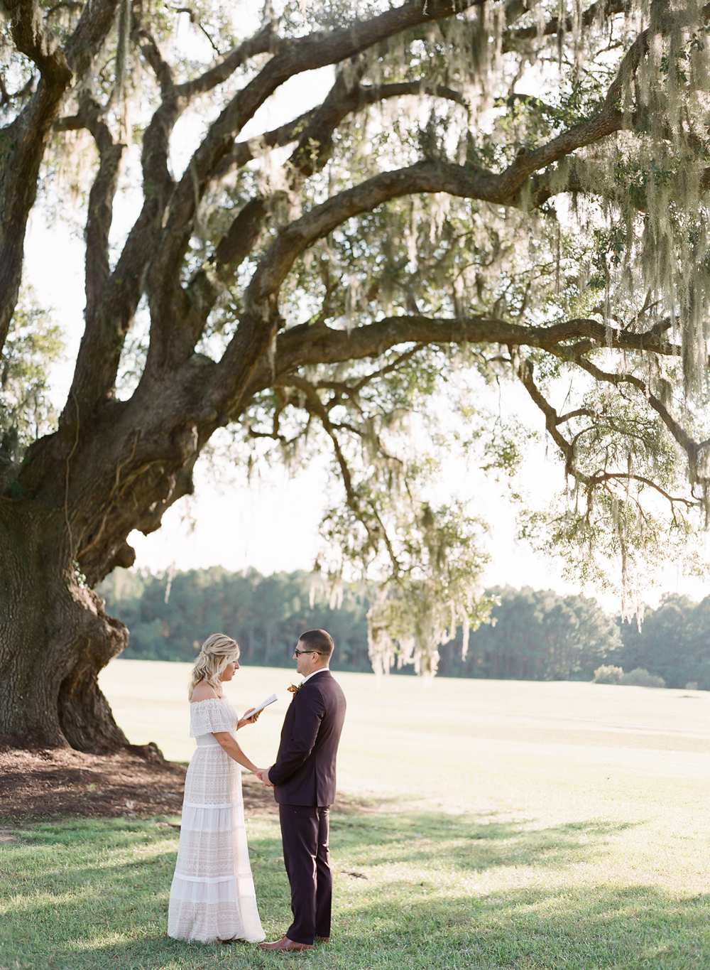 Couple exchanges vows privately under large oak tree