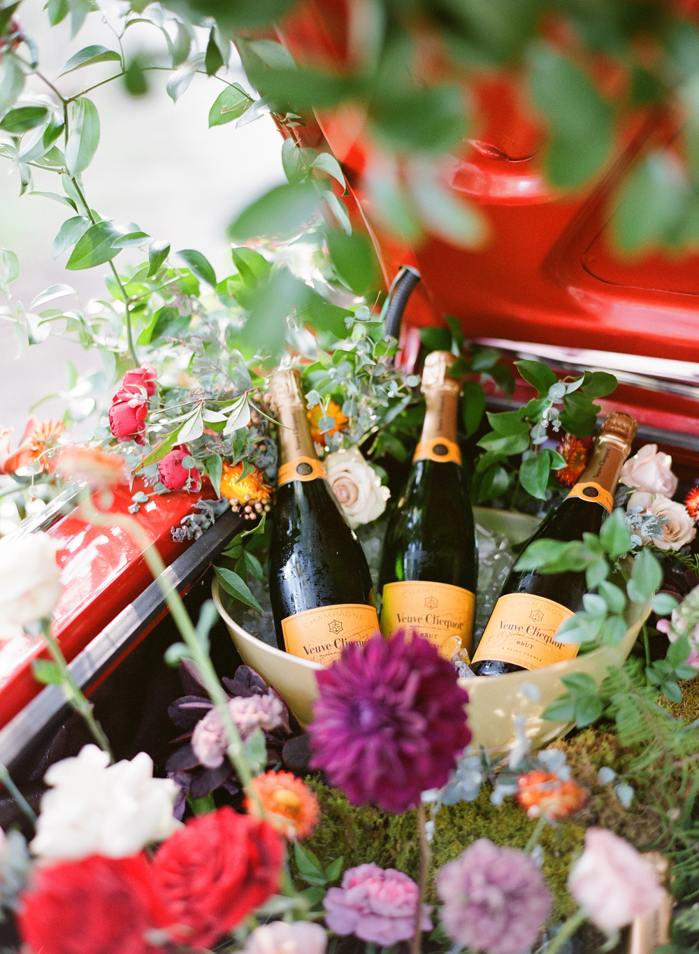 Veuve Clicquot Champagne in ice bucket surrounded by flowers