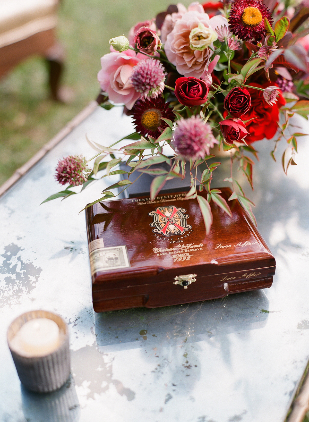 cigar case next to floral arrangement