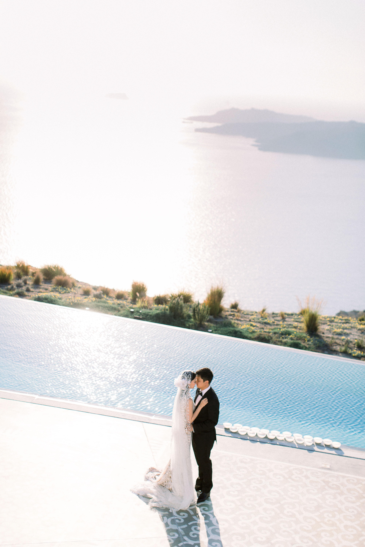angie prayogo greece wedding couple by pool