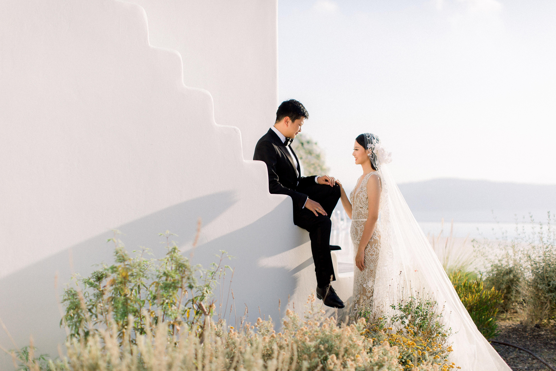 angie prayogo greece wedding couple groom sitting on stairs