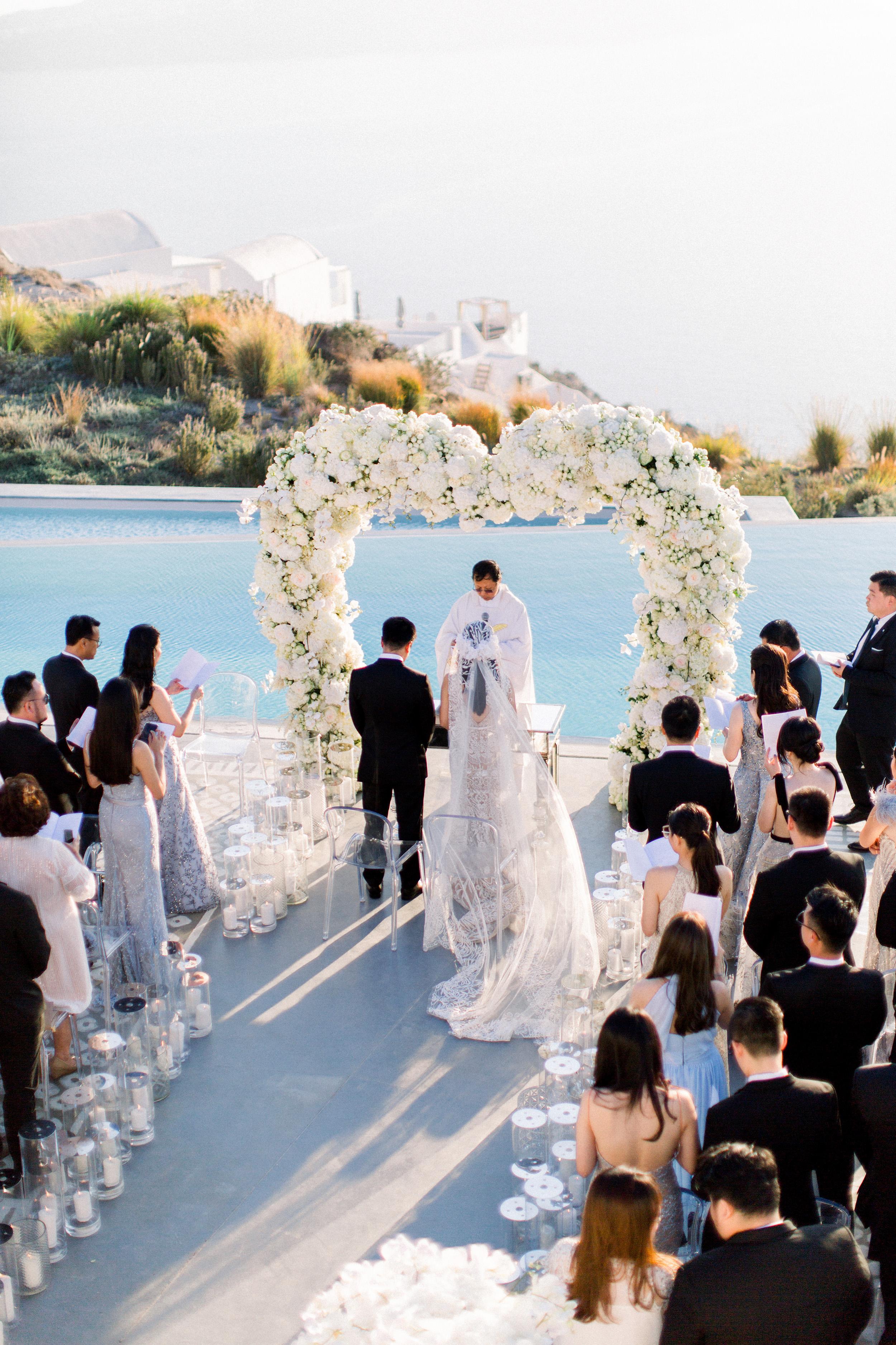 angie prayogo greece wedding outdoor ceremony couple flower arch