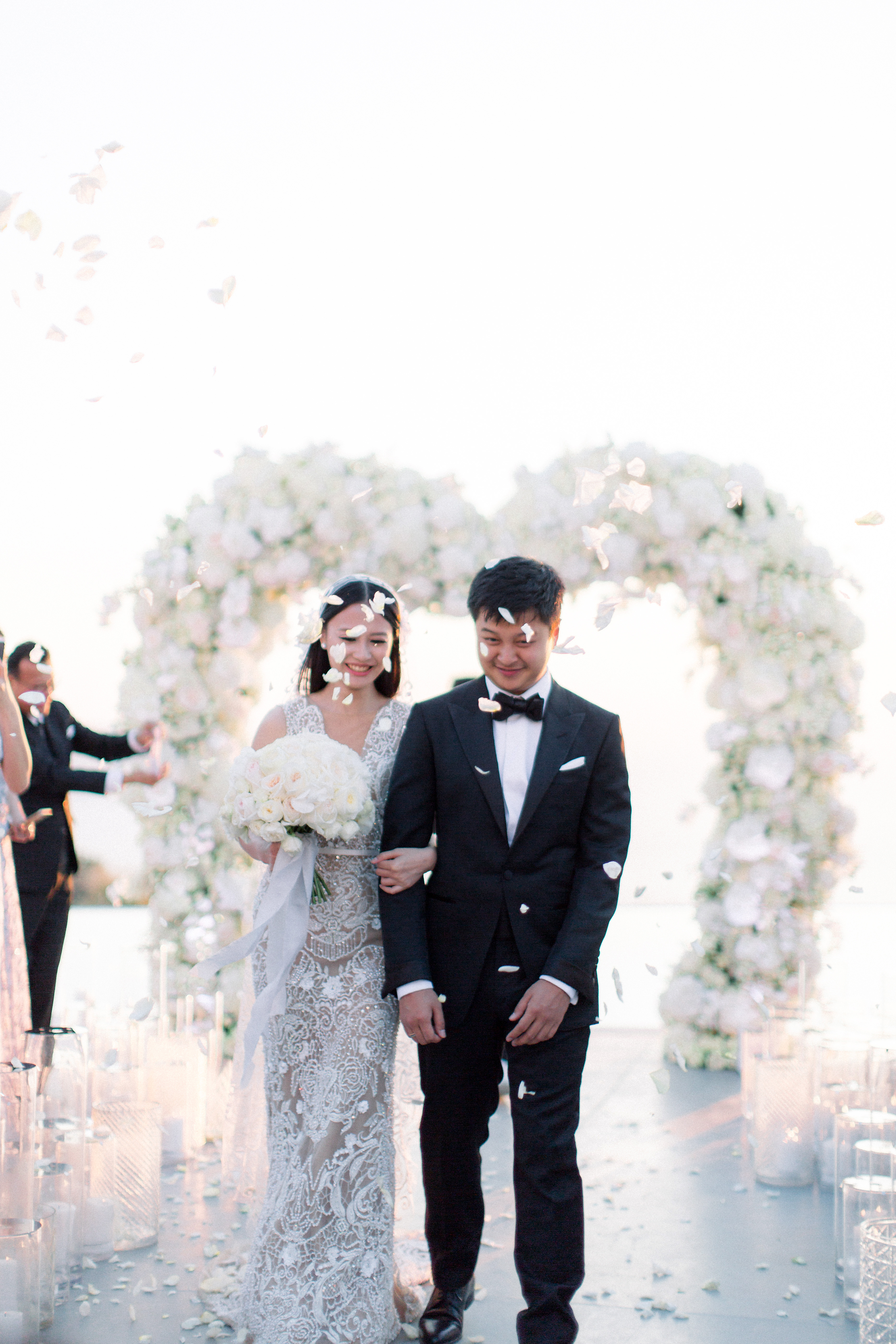 angie prayogo greece wedding recessional petals couple arch