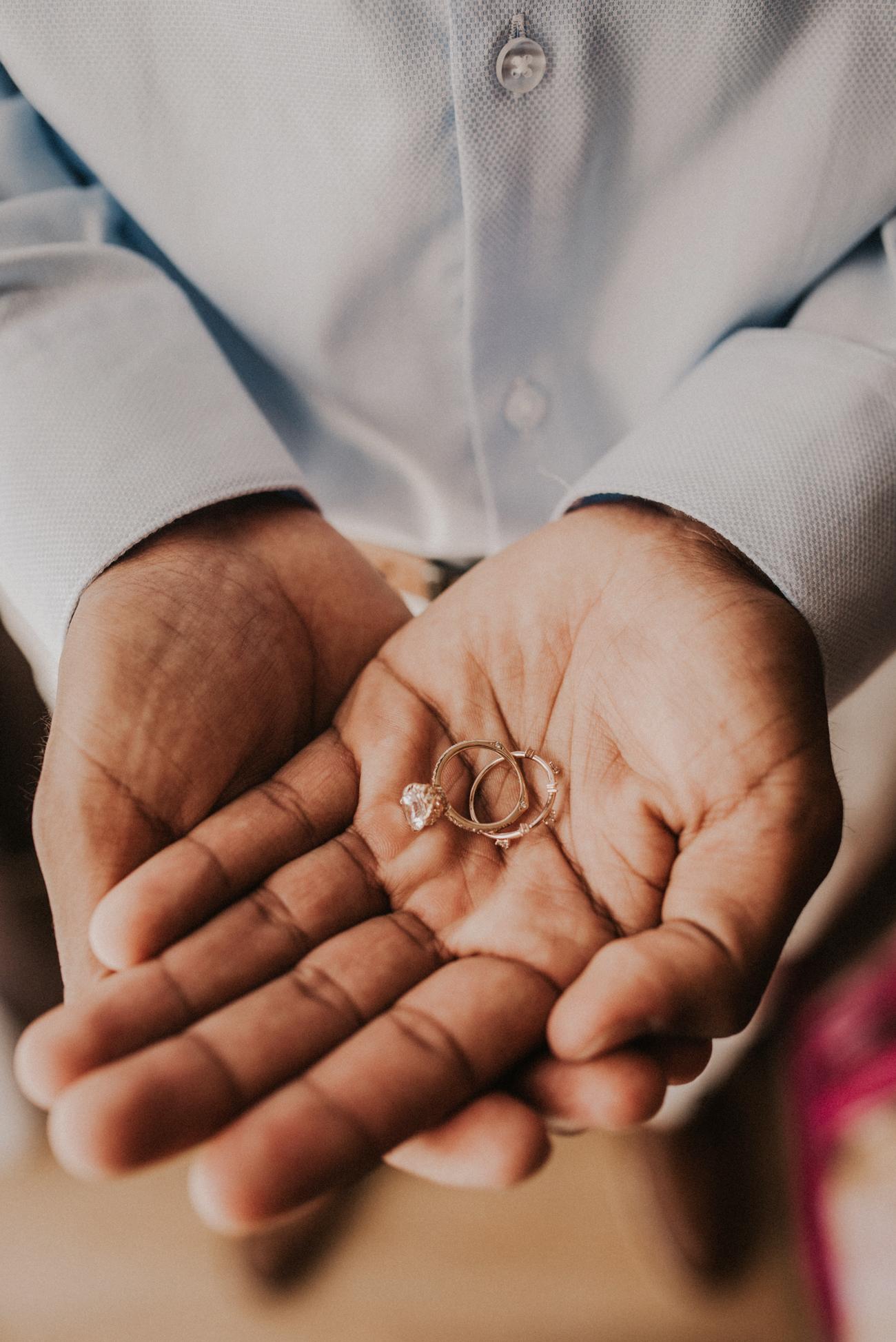 hands help open with elopement rings