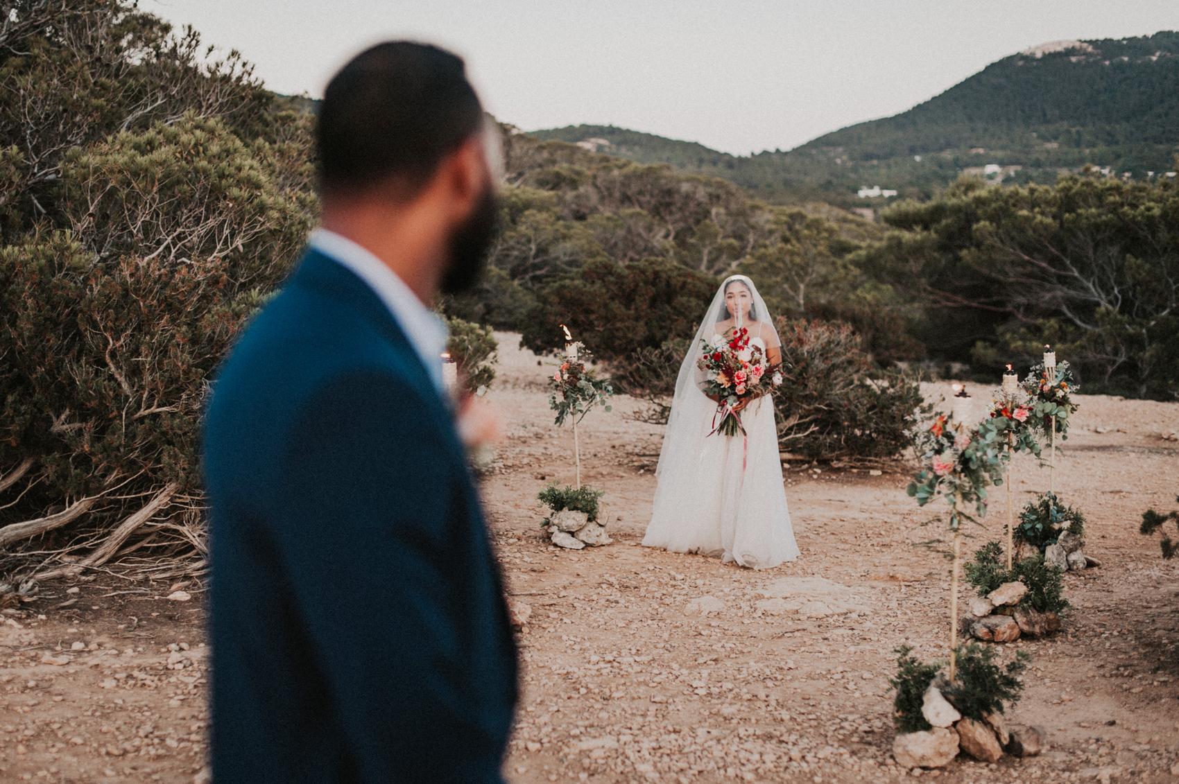 groom looks back at bride down the isle
