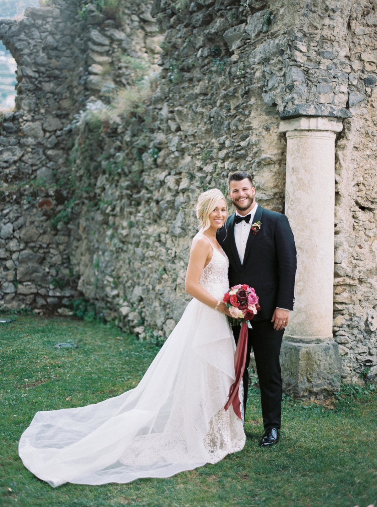 allie and joe italy wedding couple smiling outside of historic italian hotel