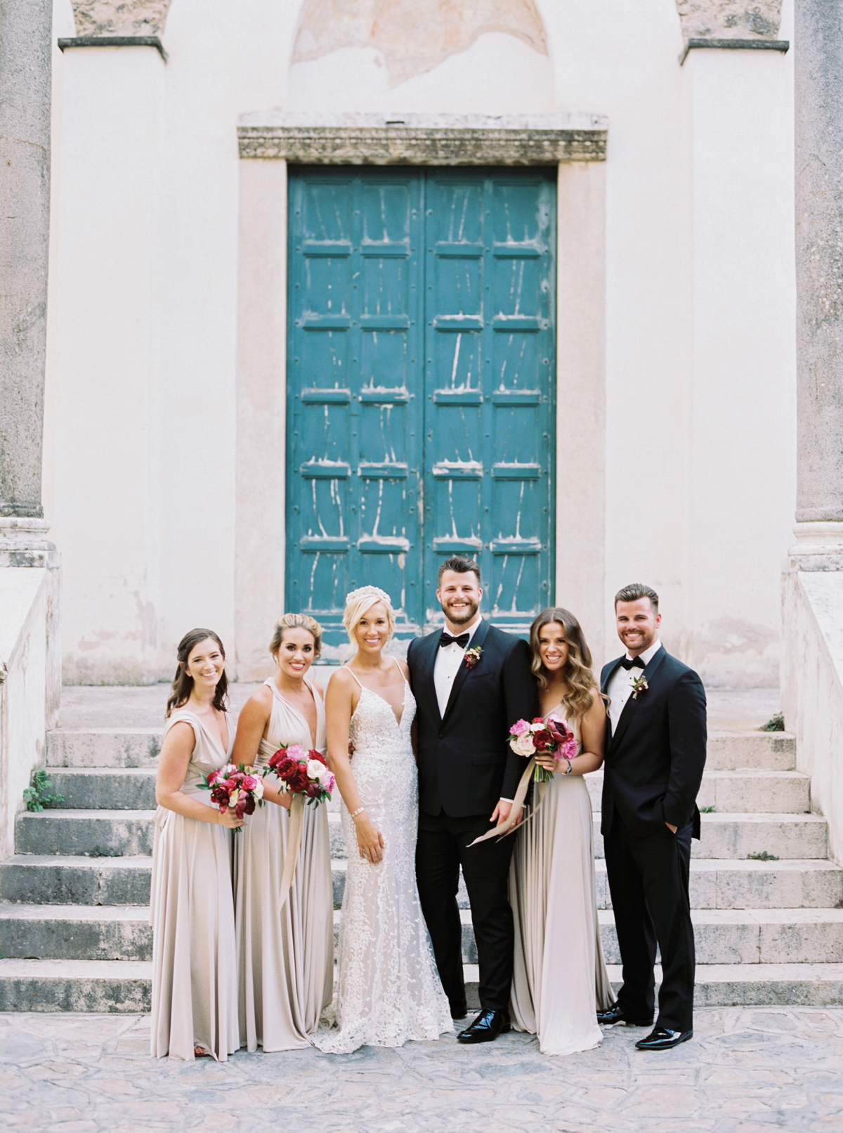 allie and joe italy wedding party outside of historic italian venue