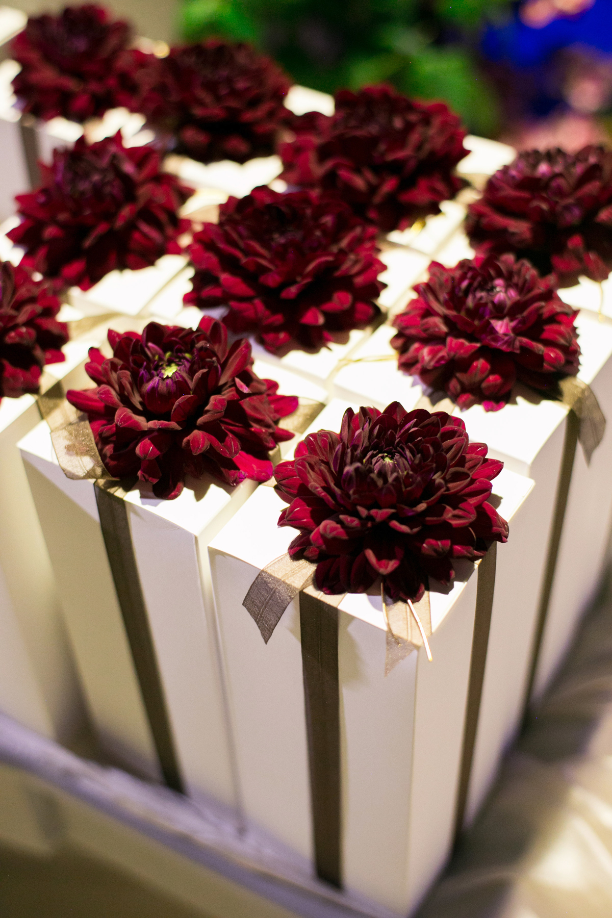 allie and joe italy wedding favors in white boxes embellished with red flowers