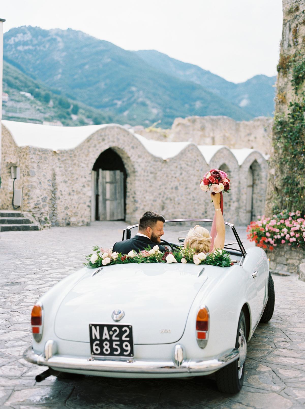 allie and joe italy wedding couple in vintage getaway car