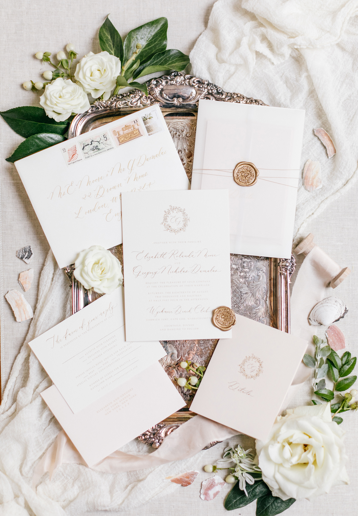 white stationary suite with wax seals