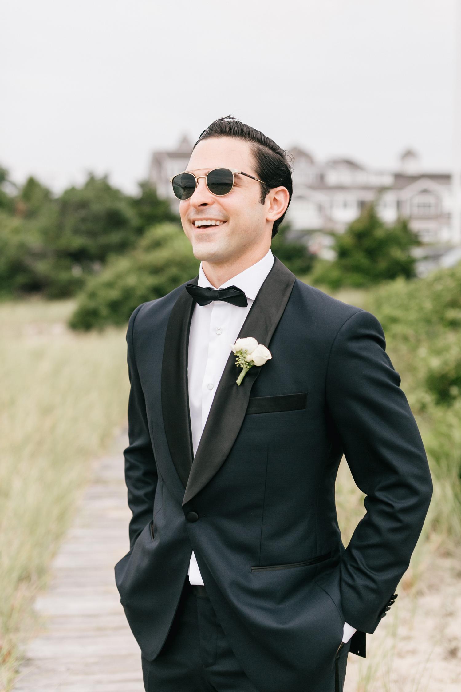 groom wearing sunglasses smiling