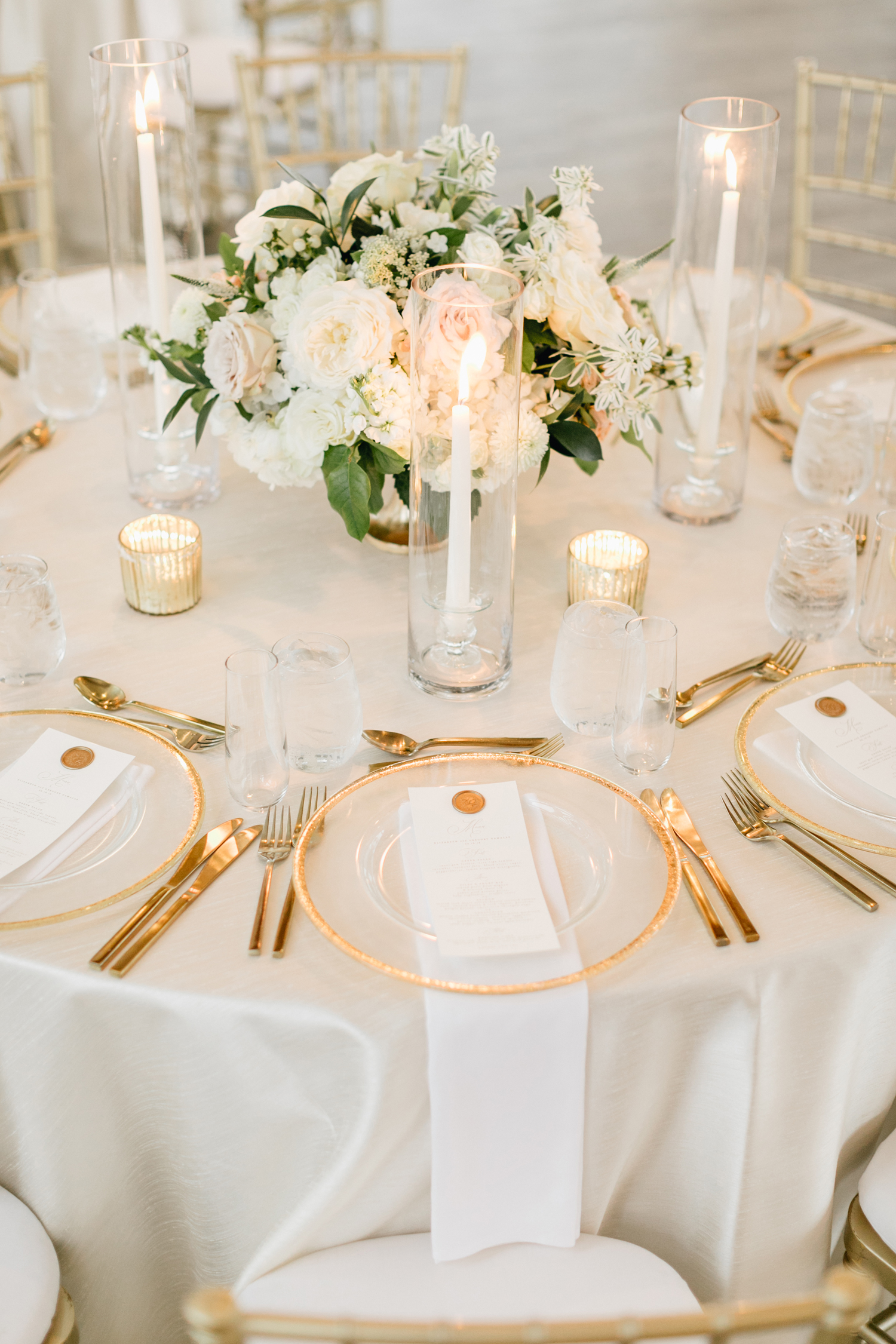 gold and white place setting on round table
