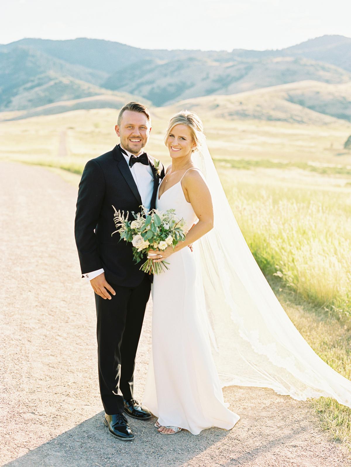 bride wearing silk slip dress wedding gown with groom