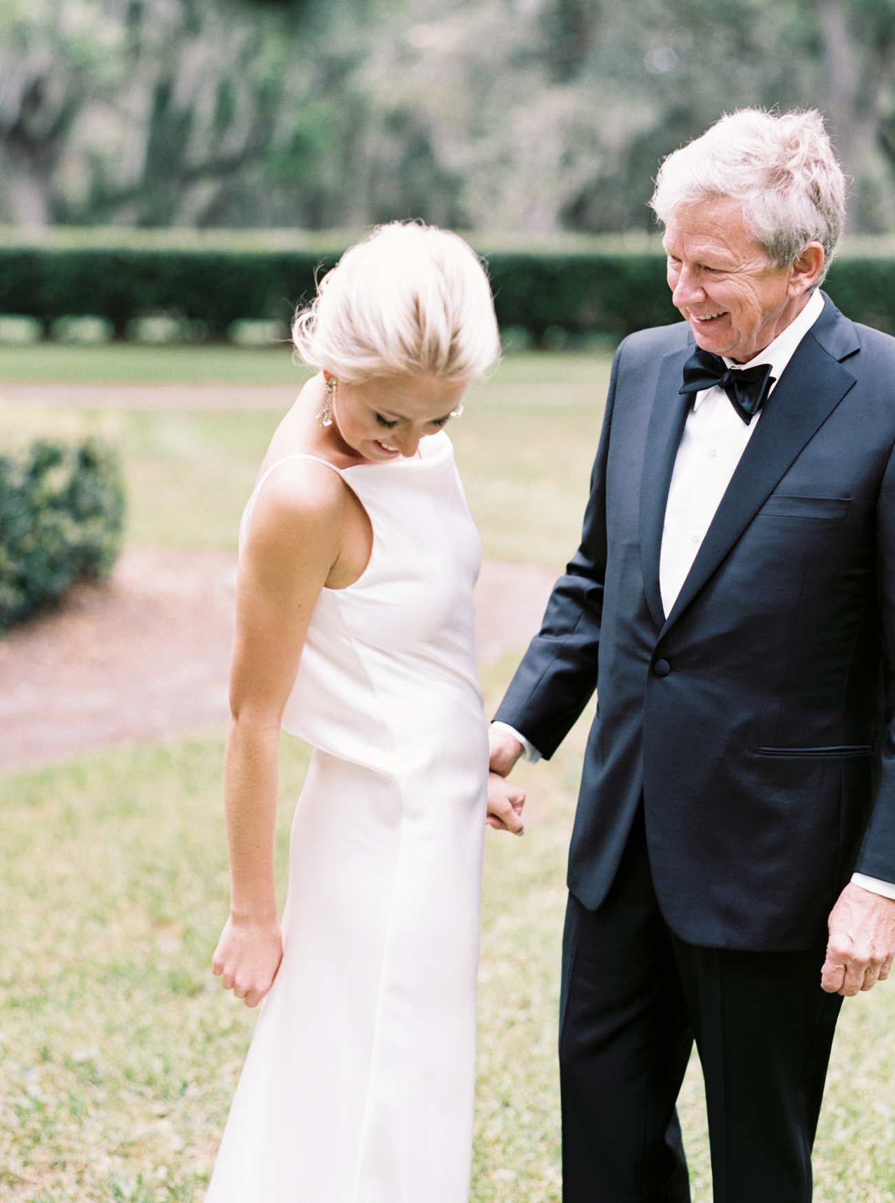 bride shares first look with her dad before the ceremony