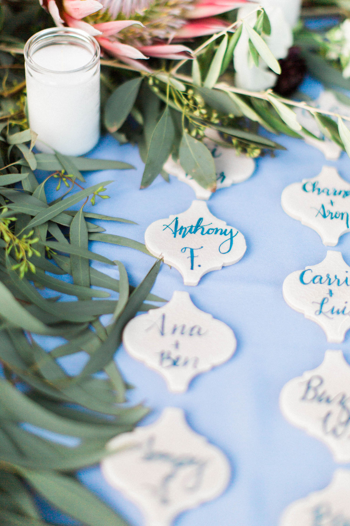 guests names on lantern-shaped escort card tiles